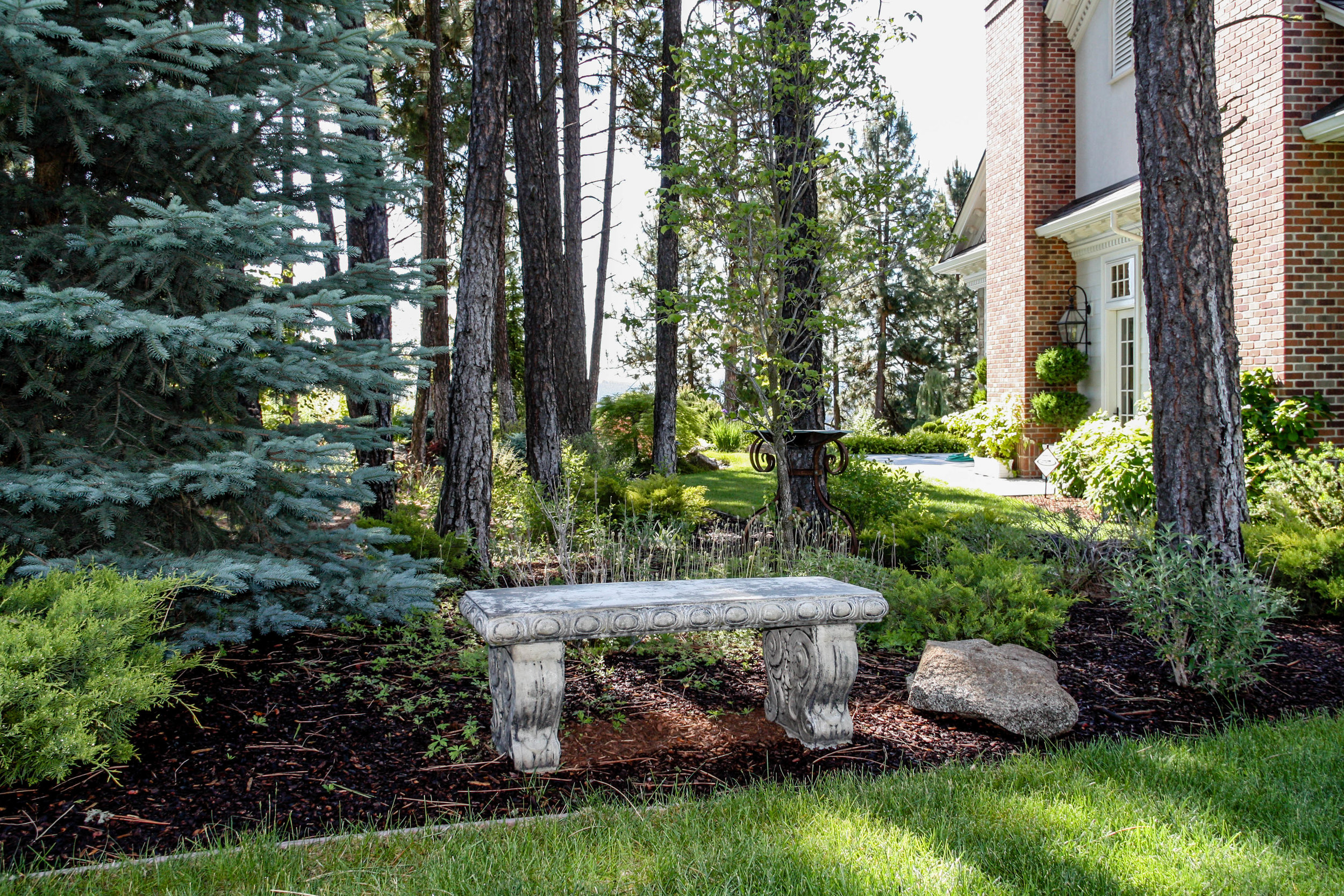 spokane rural estate landscaping bench in woods