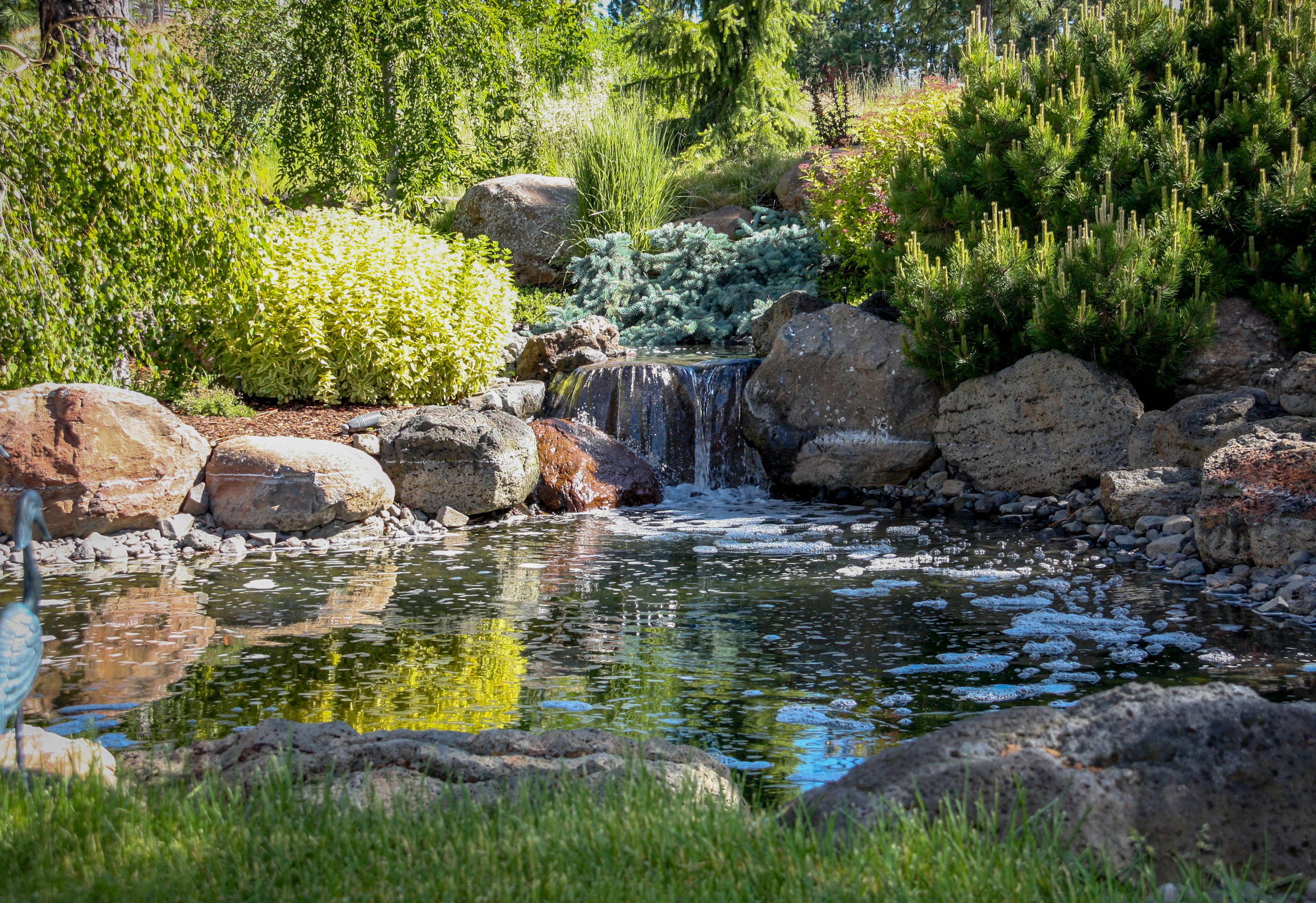 natural pond water feature with waterfall spokane