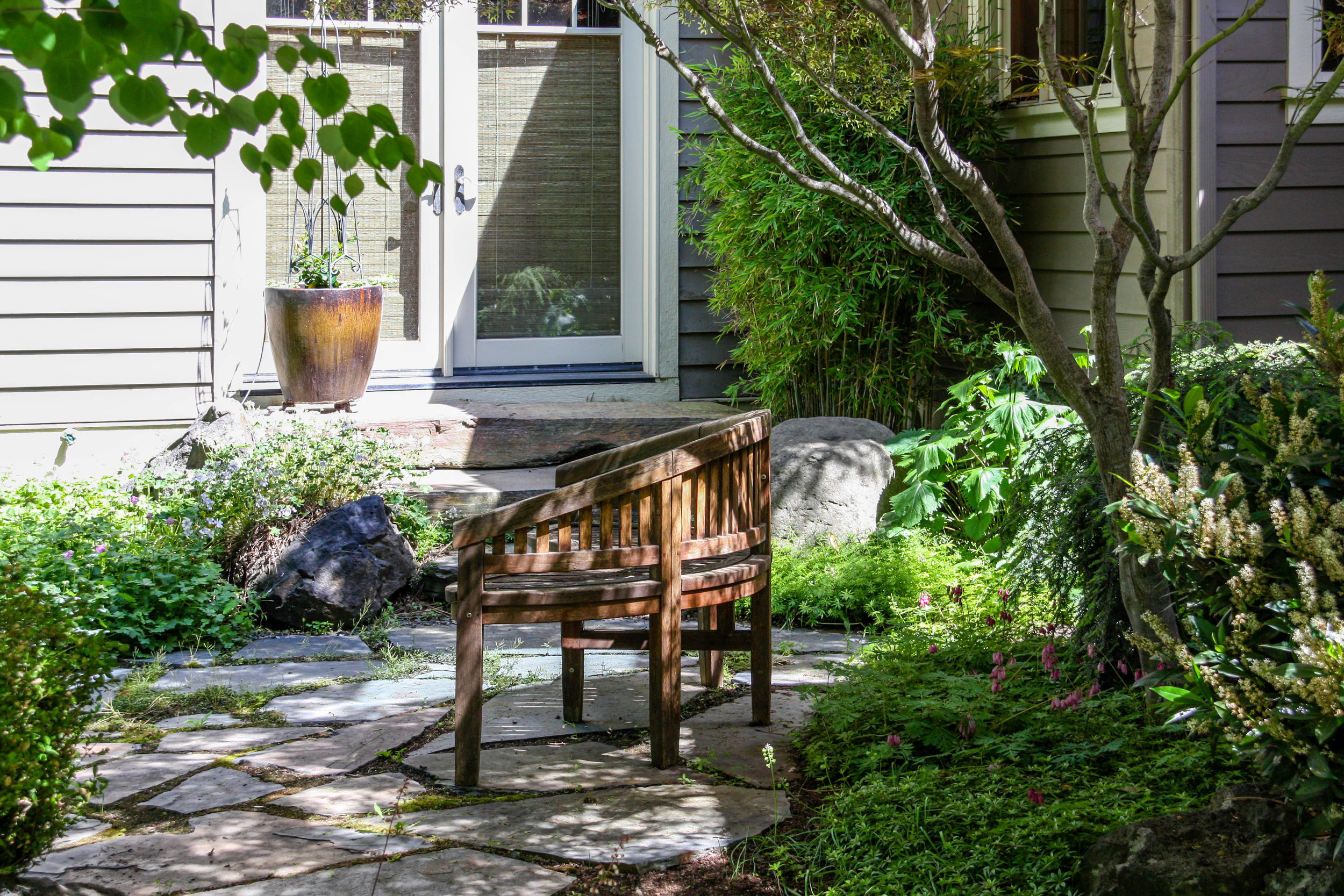 south hill craftsman with shady flagstone patio