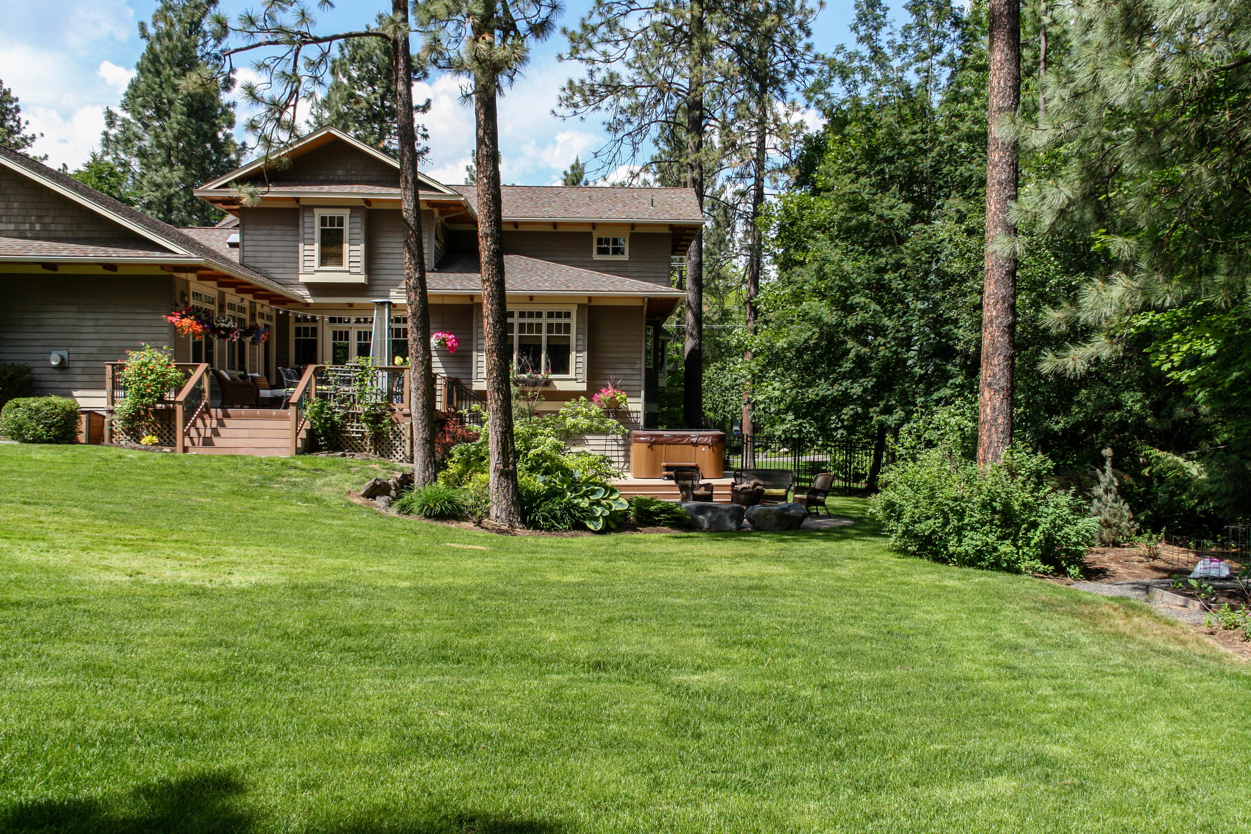 rockwood craftsman landscaping with multi-level deck and patio
