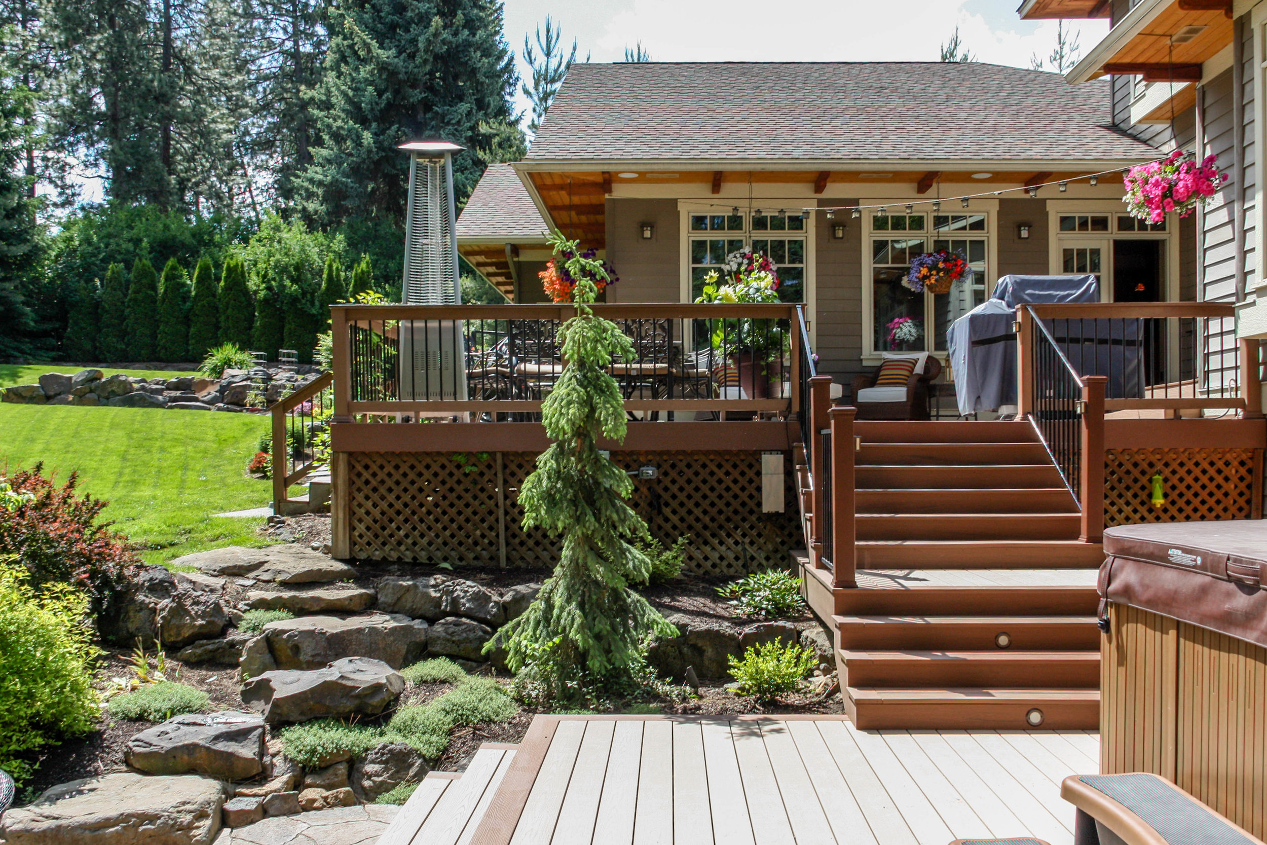 multilevel deck with boulder retaining wall and rock steps