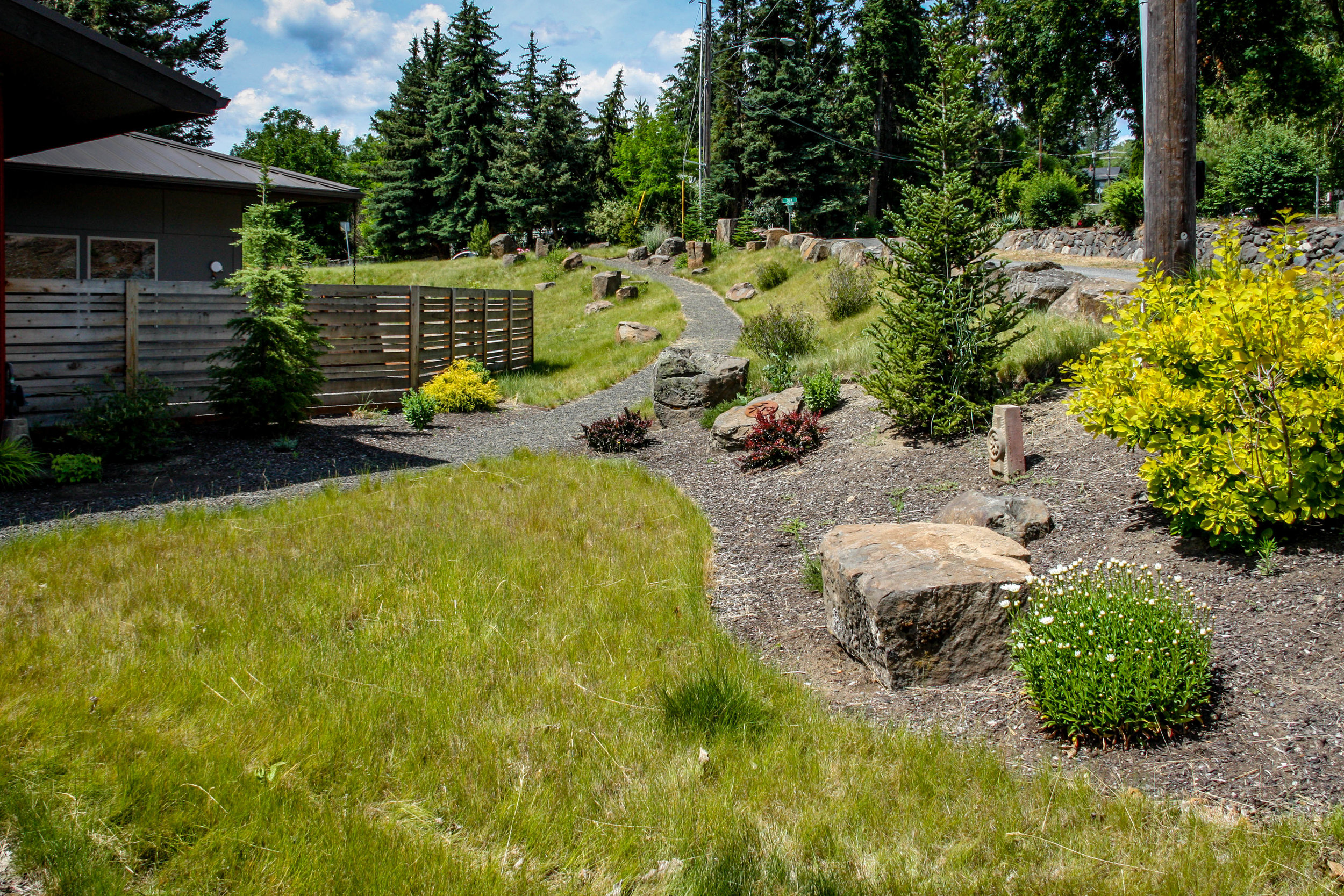 horizontal wood fence and low maintenance spokane landscaping