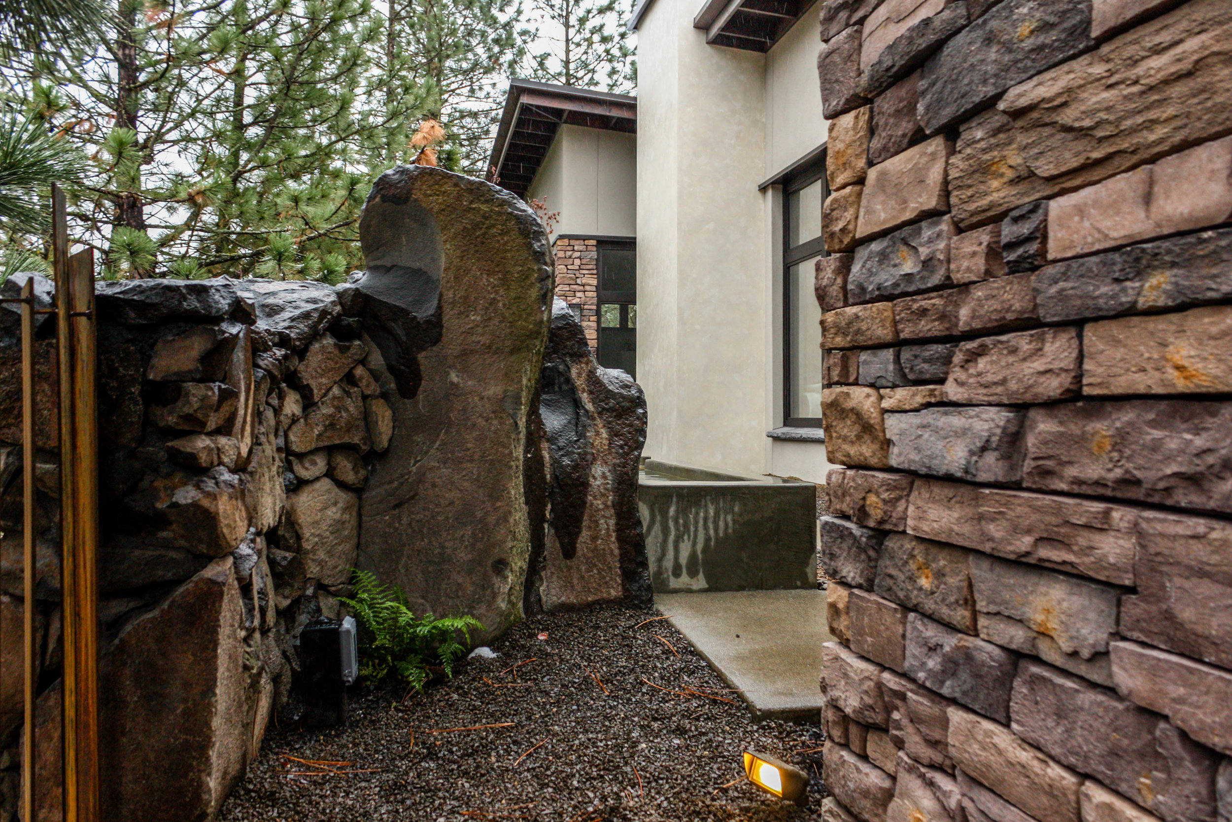 basalt wall integrated with water feature in spokane south hill landscape