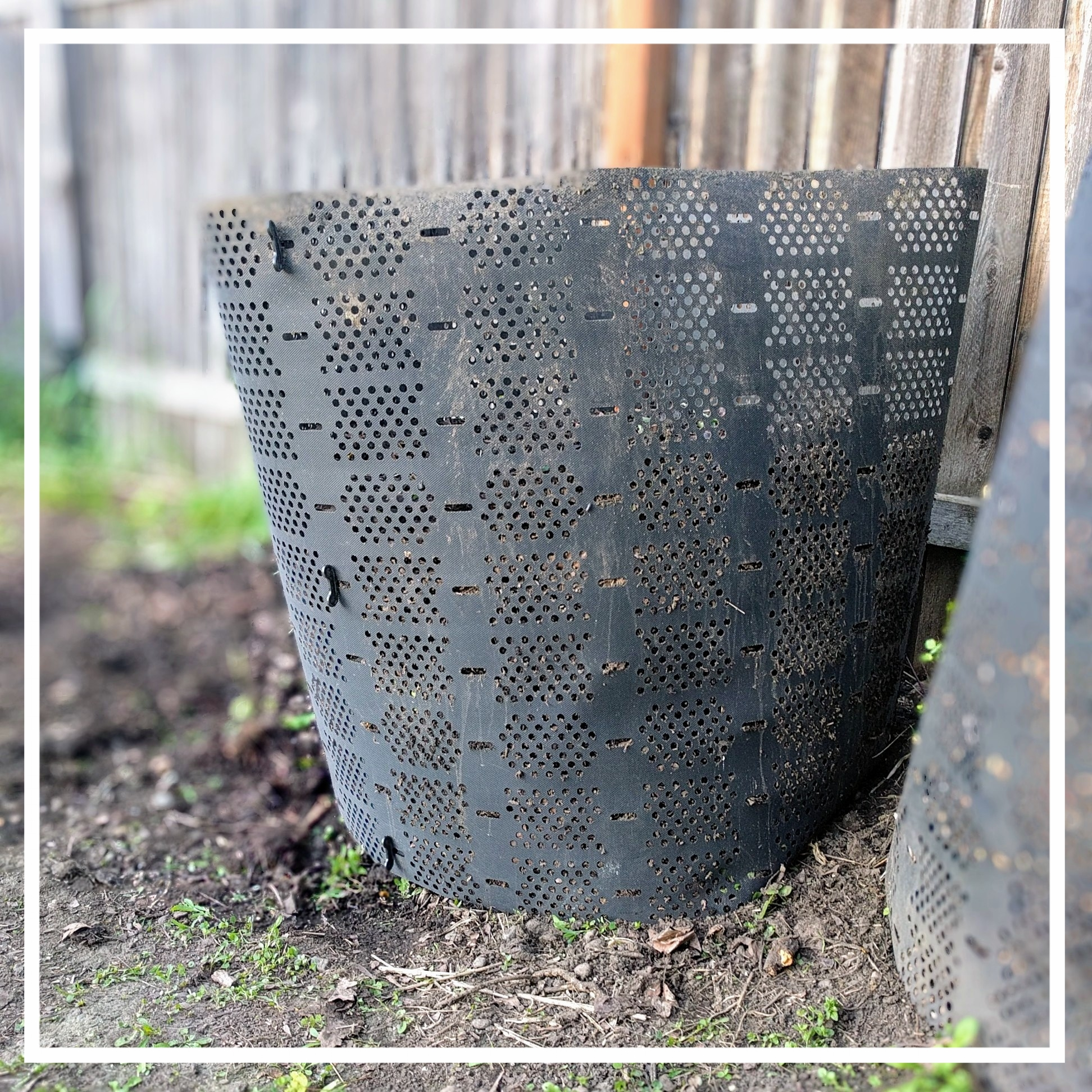 This plastic mesh bin can be unclipped and repositioned to make it easy to turn the compost pile.