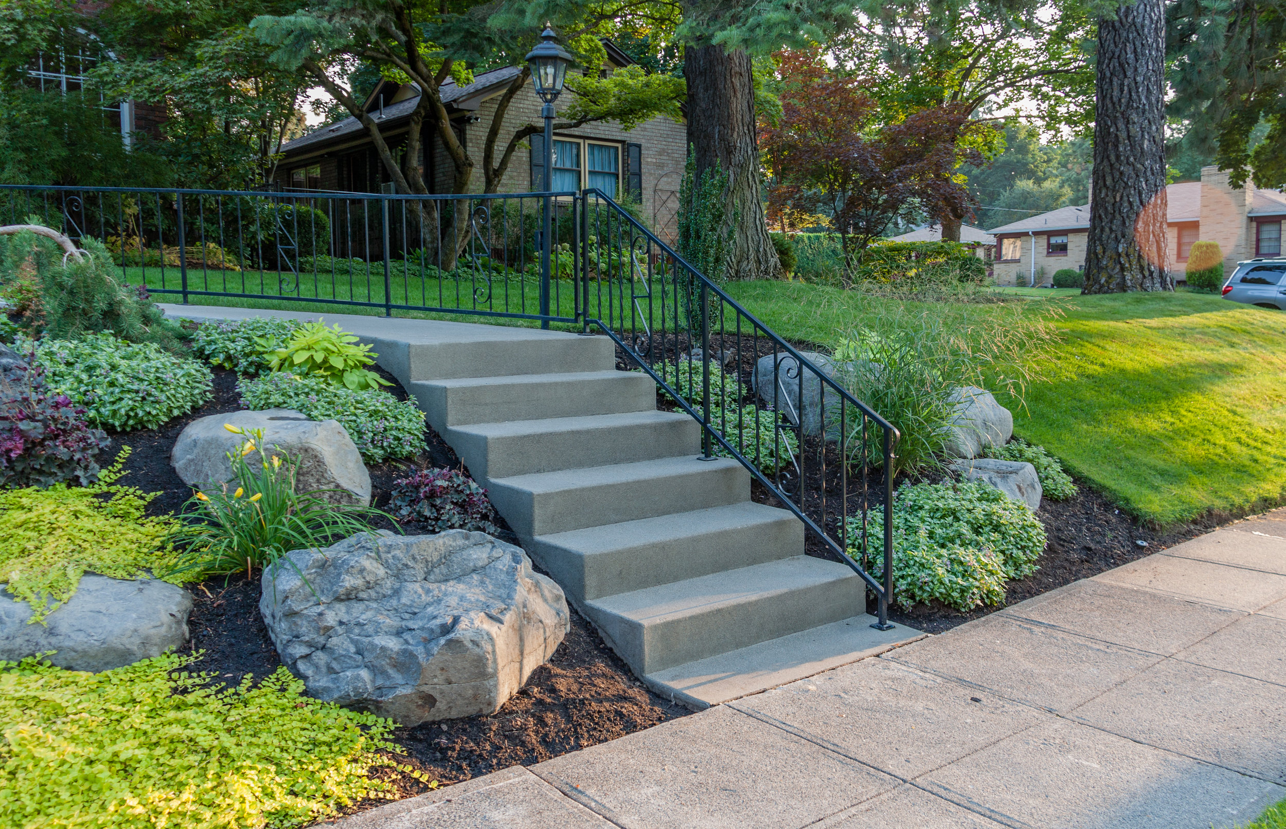 sandwashed concrete steps and boulder outcroppings