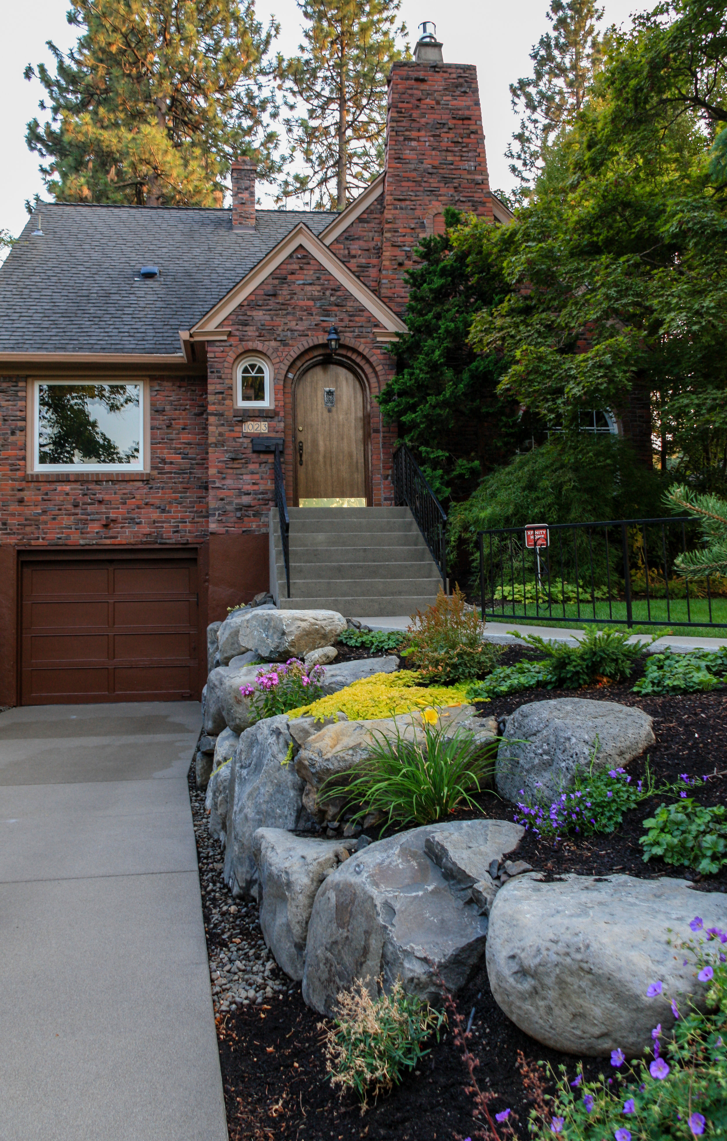 boulder retaining wall with landscaping for spokane 1930s bungalow