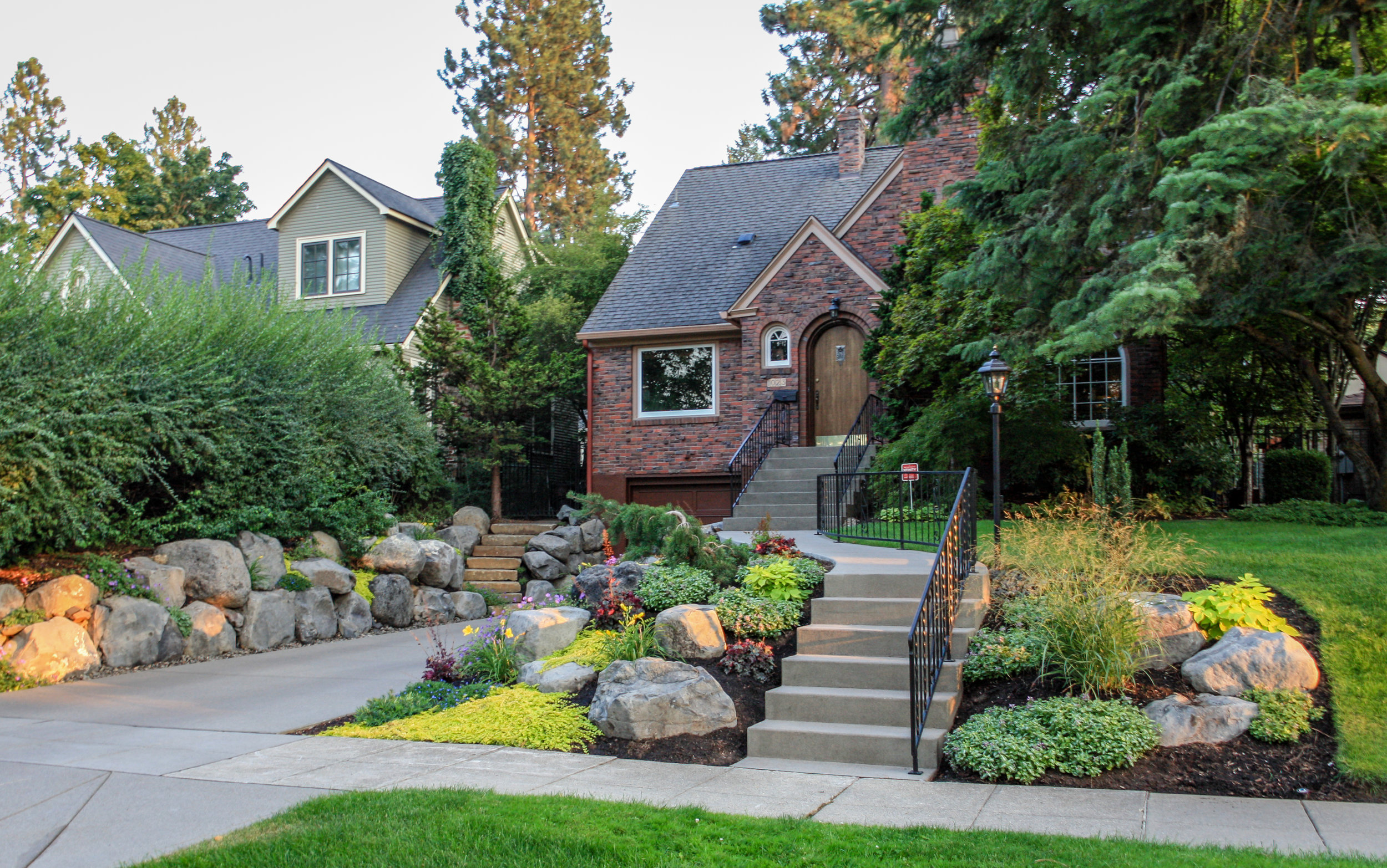 sandwashed concrete steps and driveway with landscaping in spokane