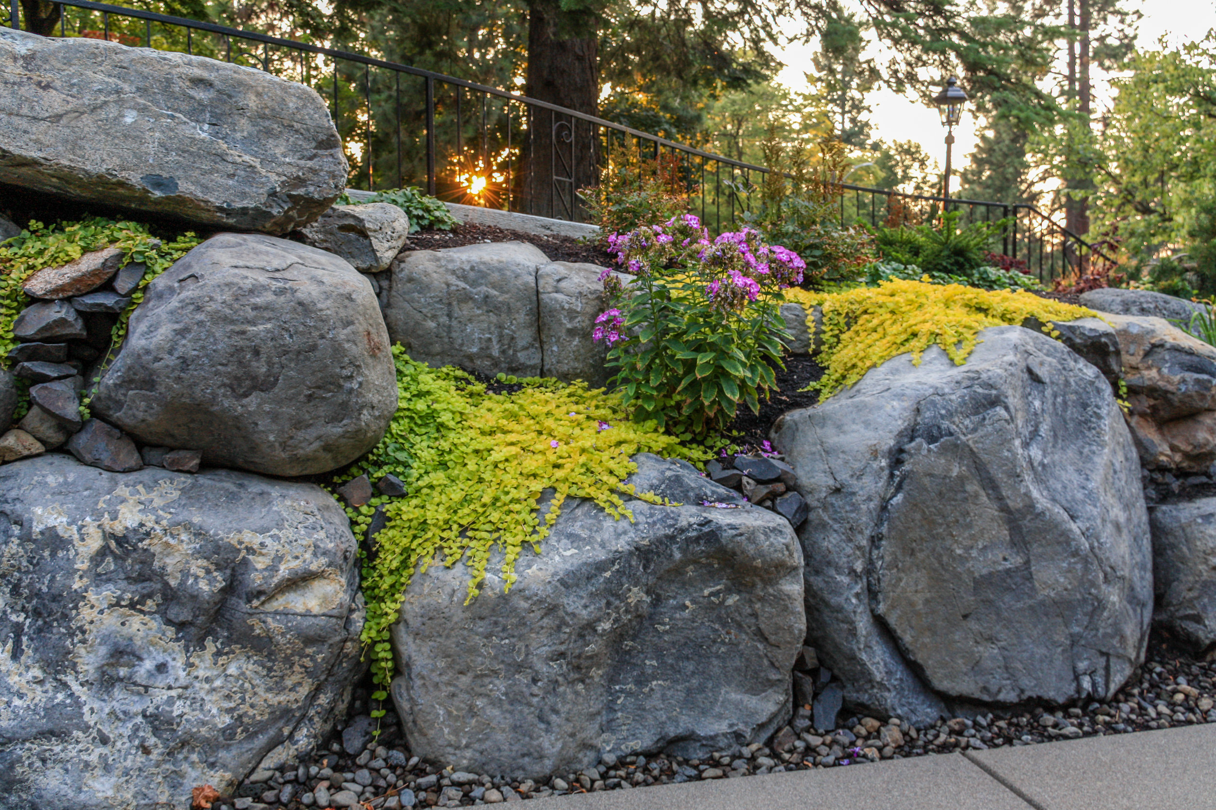 spokane boulder retaining wall with rock garden landscaping