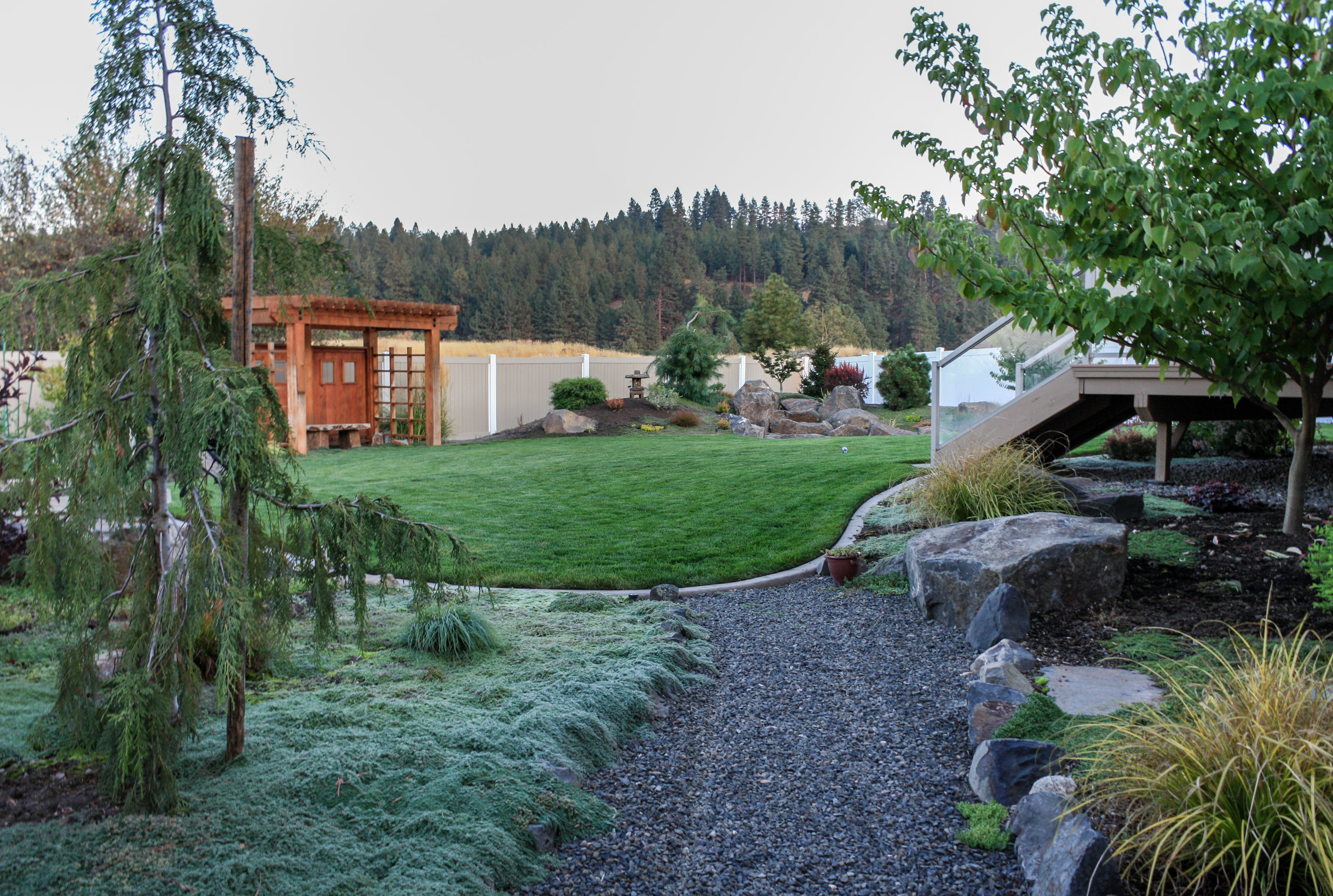 spokane valley asian landscaping with pergola and dry water feature
