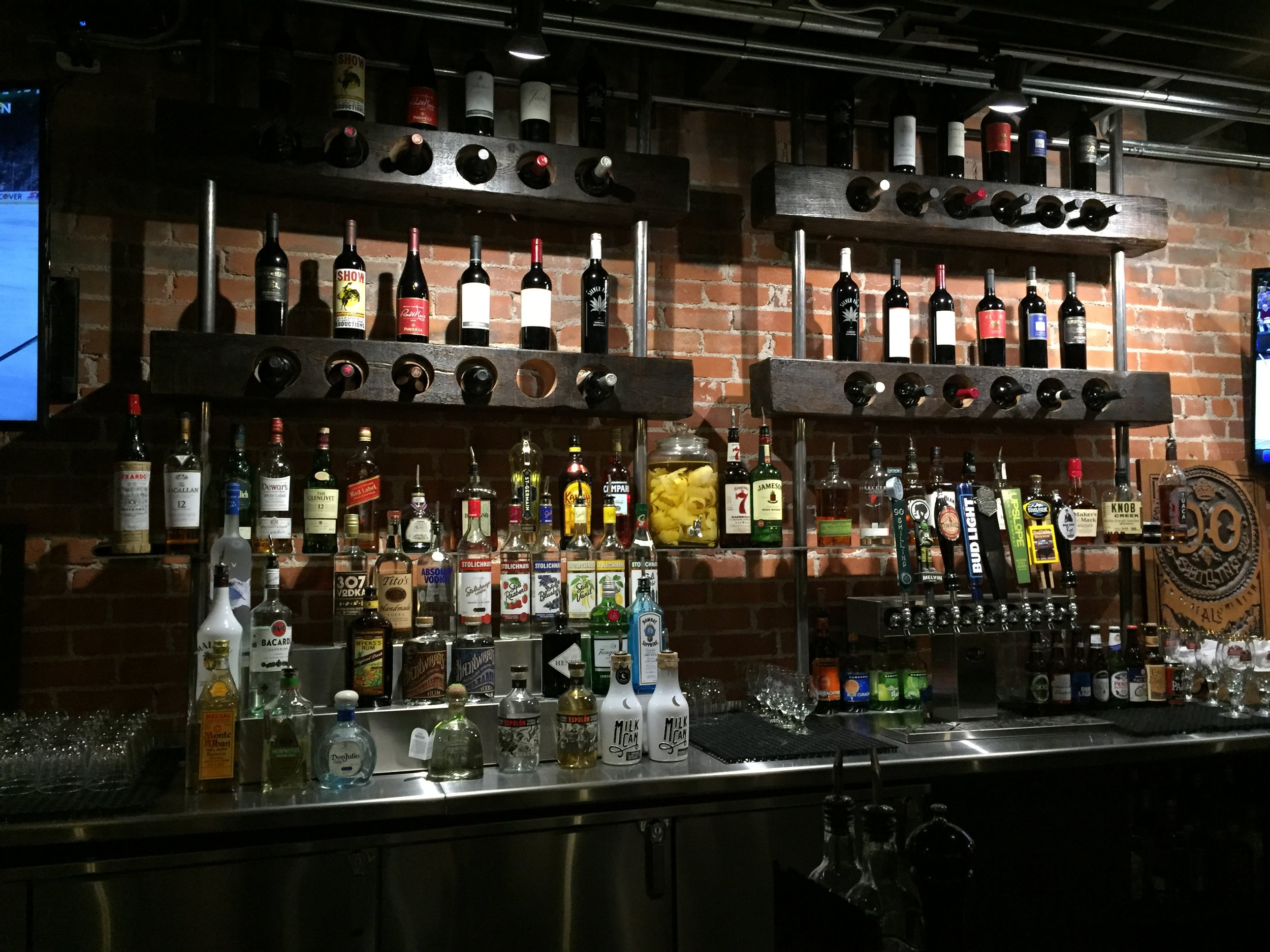 Full bar, featuring local brewery's and distillers.