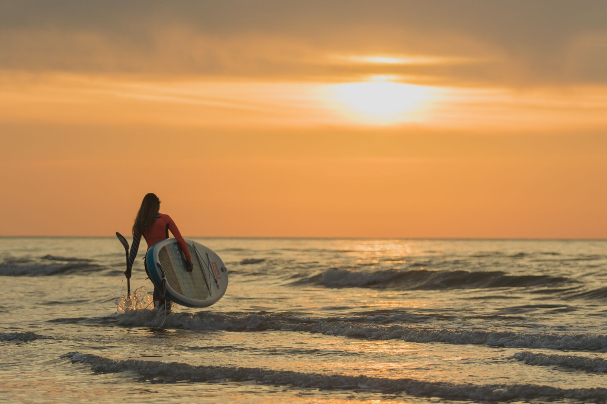 Lizzie Carr paddle boarding. Photograph © Lizzie Carr