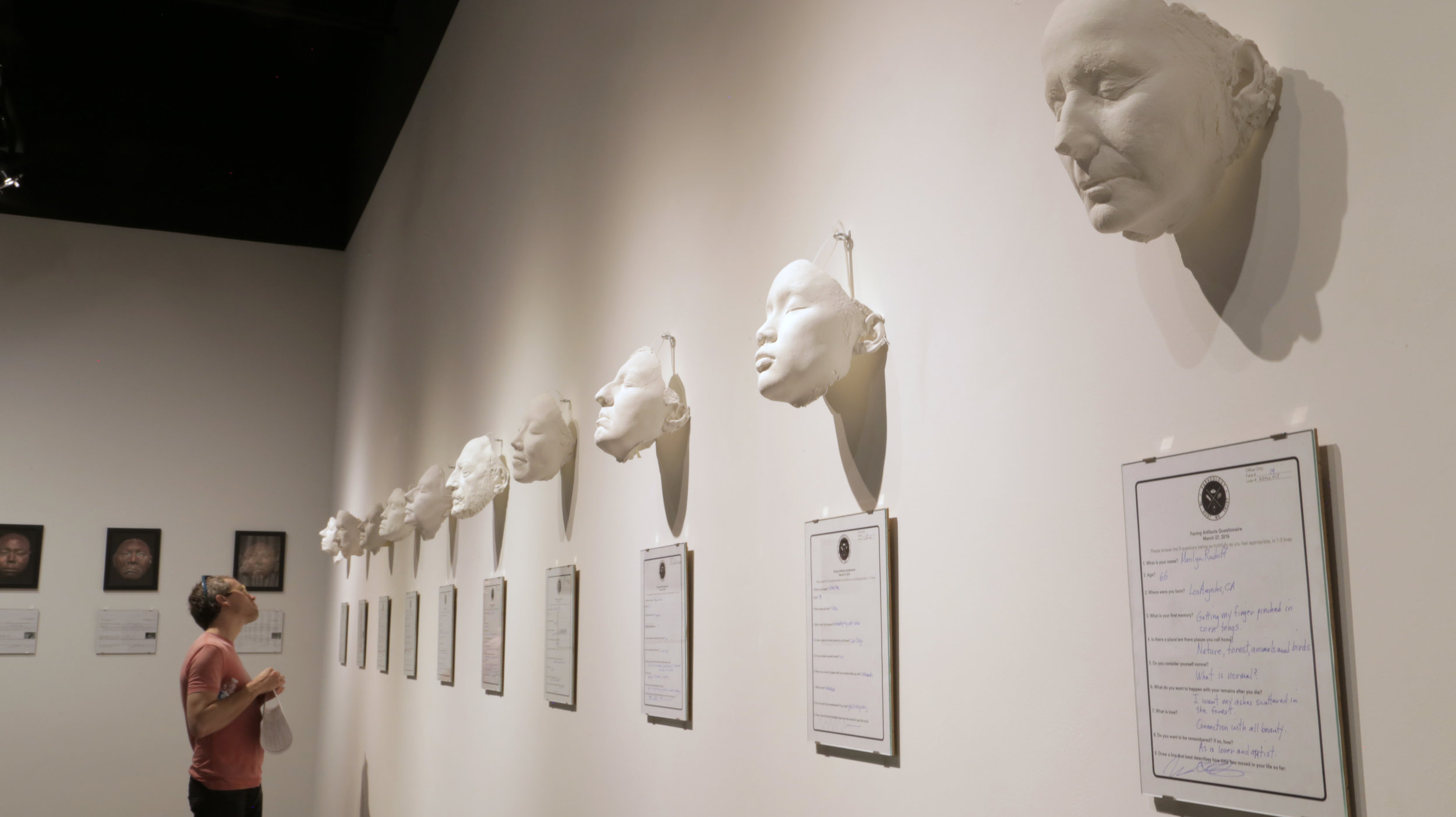 "Contemporary face casts on display for the exhibit ""In Dust We Trust"" at the San Diego Art Institute"