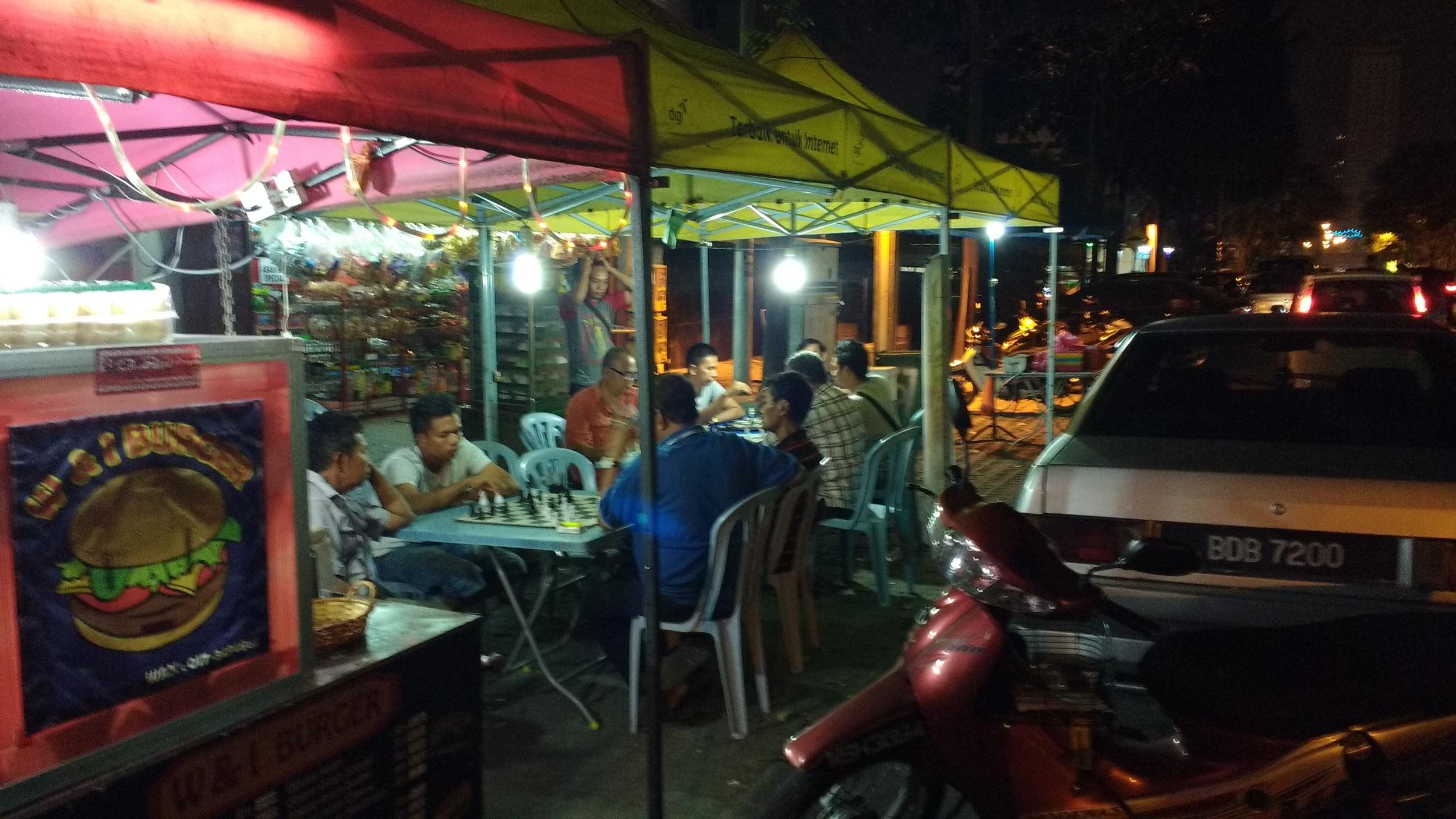 Residents join in for a street-side game of chess on Jalan Raja Alang, Kampung Bharu. Photo: Vishnu Prasad