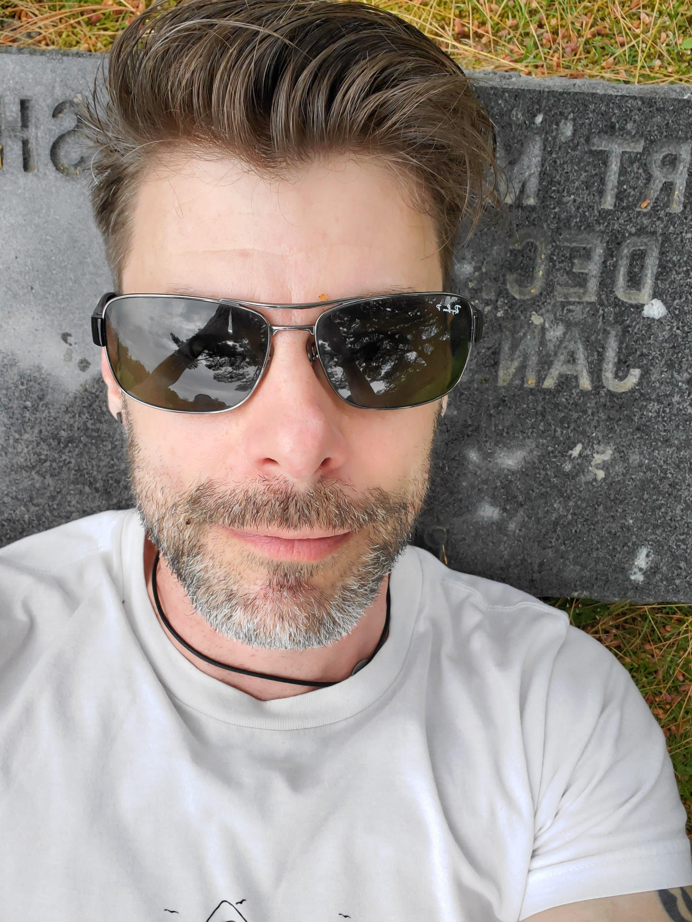 The pillow of my Dad's grave - sunglasses hiding the tears