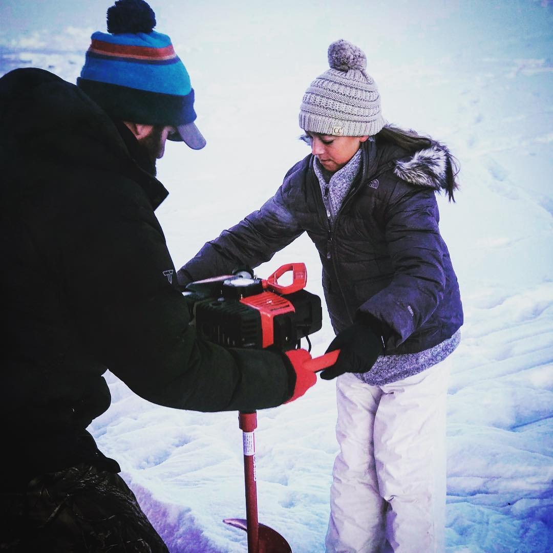 Everyone gets to help drill the ice fishing holes!