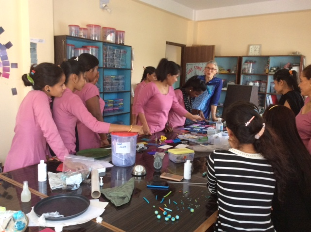 Wendy at the head of the table wearing some sort of Cyan, and her students in made-to-match Magenta