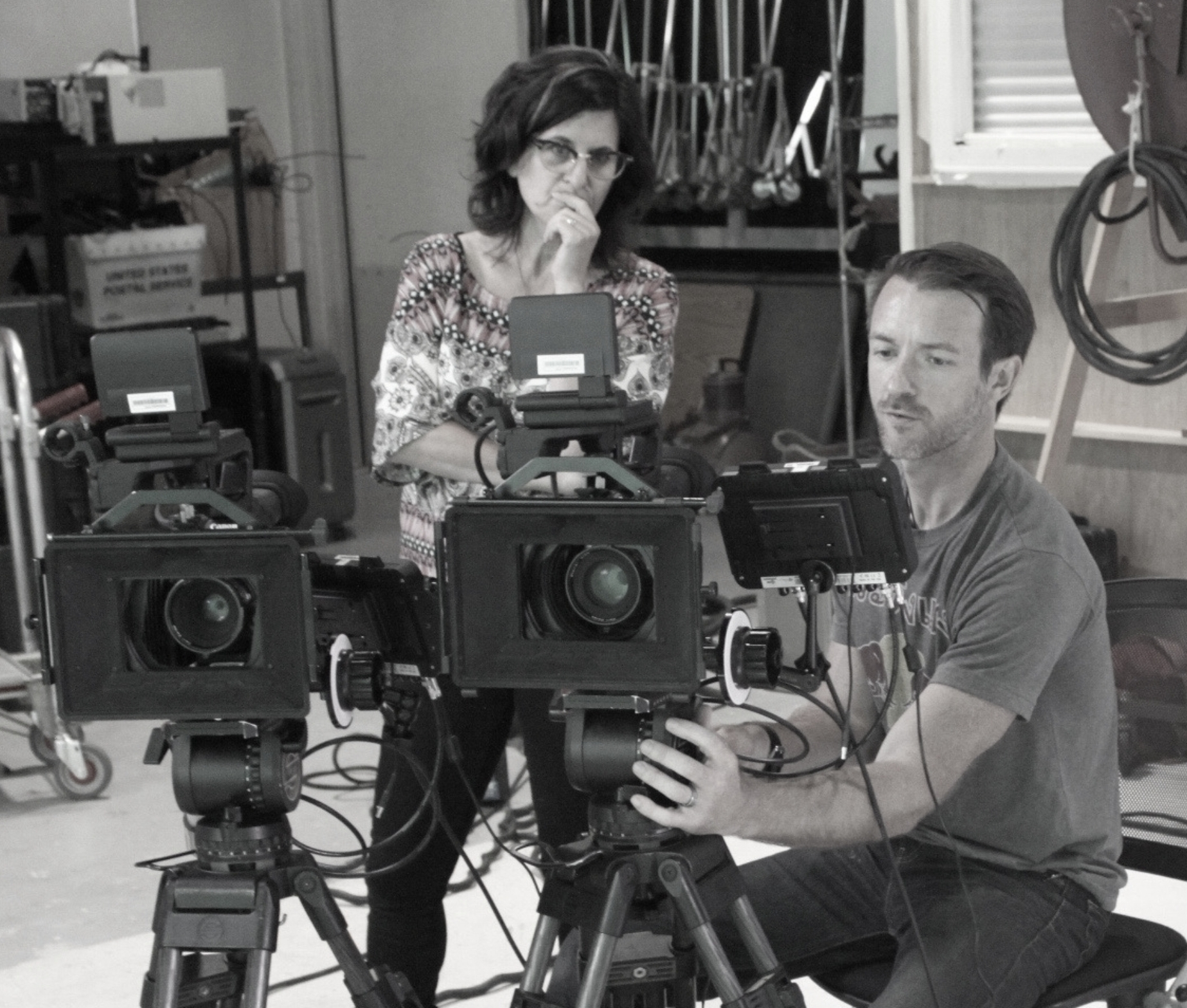 Cinematographer Joel McGinty and documentary director Debra Tolchinsky prepare to interview Penny Beerntsen for the documentary True Memories and Other Falsehoods