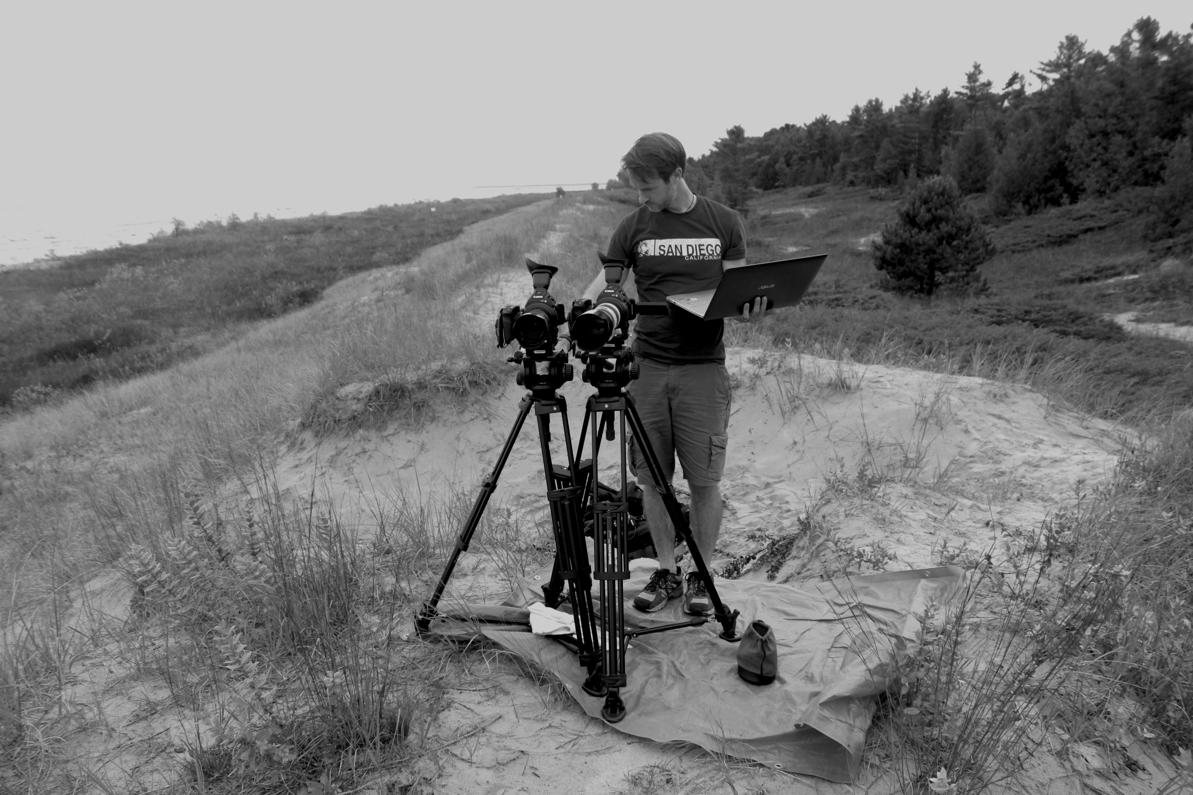 Joel McGinty setting up to shoot at Point Beach State Park for the documentary True Memories and Other Falsehoods
