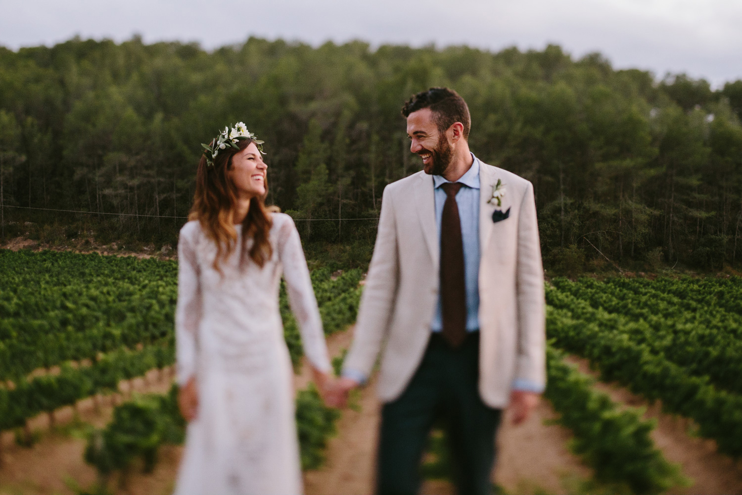 bride and groom in the olivella vineyards