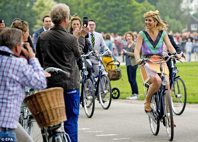 Queen Maxima of the Netherlands, arriving at an official function on her bike.