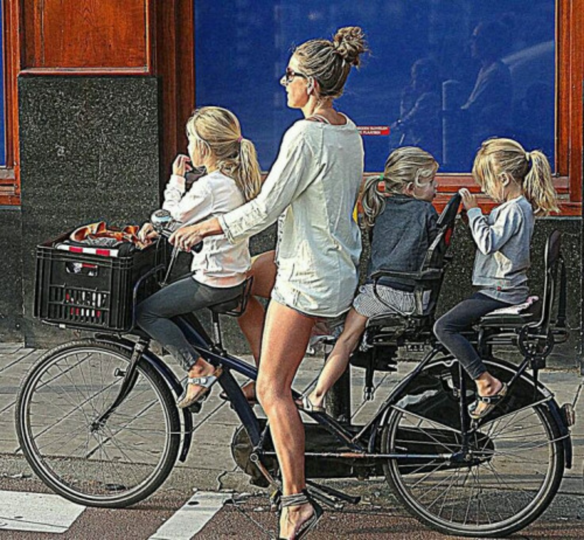 The most ubiquitous image of a mother on her bike in the Netherlands; but jeebers, check out those calf muscles !