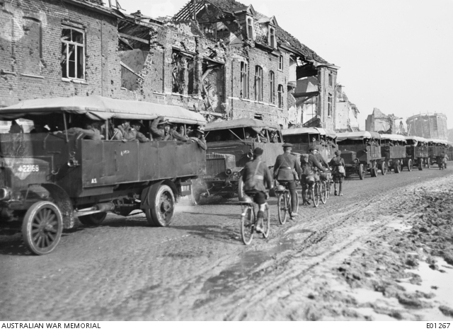 Flanders 1917; Kiwi troops being transported by truck, but note the soldiers, including a Scotsman in his kilt, riding in the opposite direction
