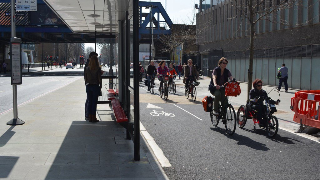"""Safe and separated bike lanes in London, with a """"floating"""" bus stop. So safe that @IsabelleClement of Wheels for Wellbeing feels safe on her handcycle."""