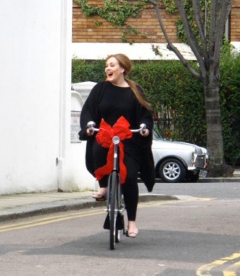 Adele as happy as a kid with a new bike ...