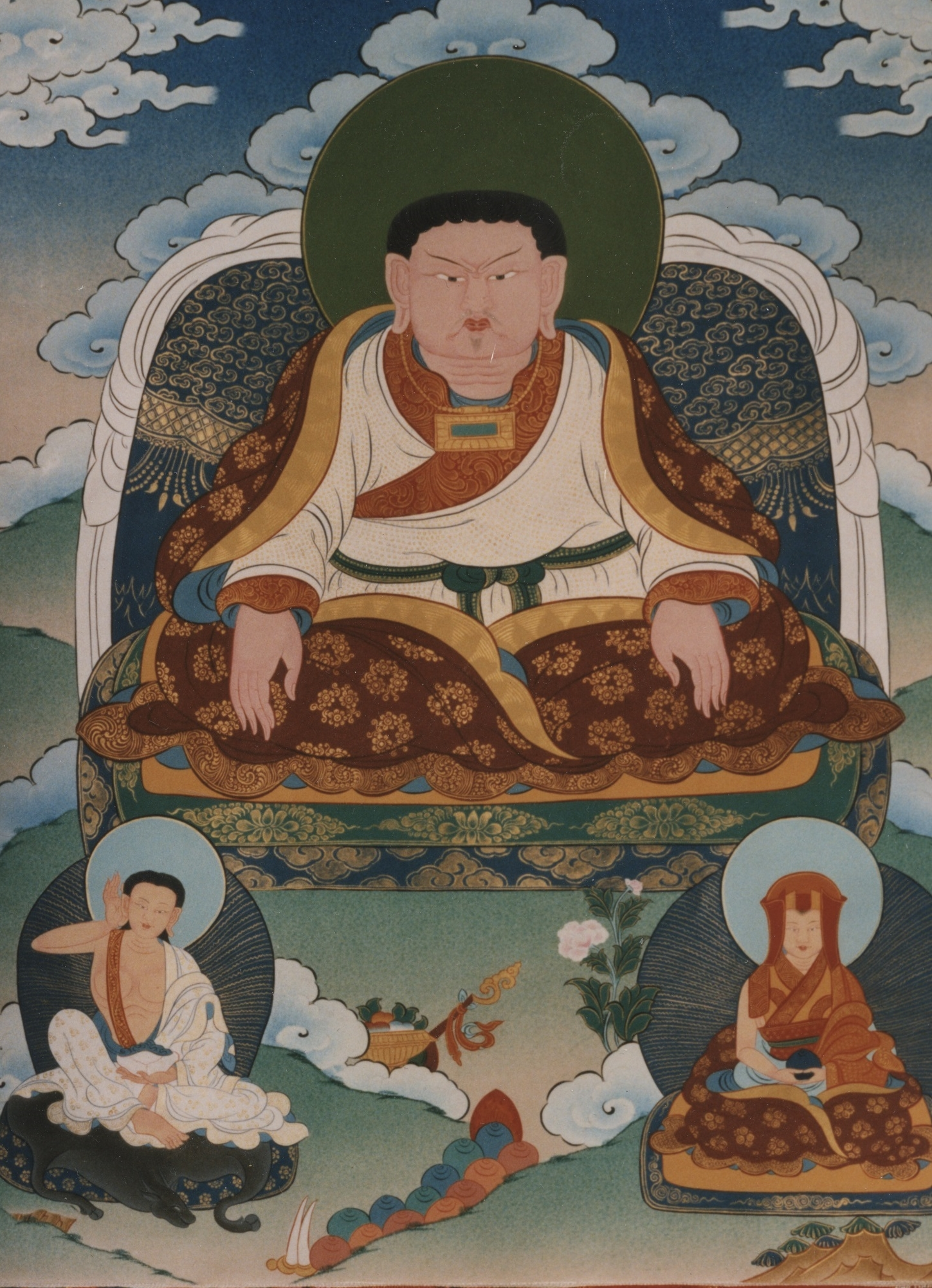Marpa with his student Milarepa below left and Gampopa below right