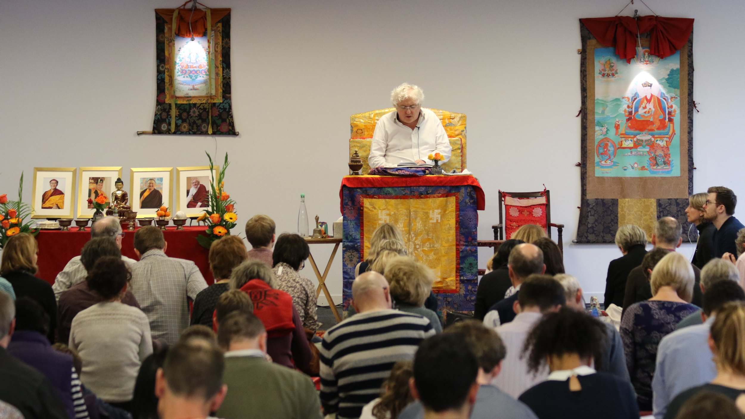 Students listening to Lama Jampa's lucid explanation of the text