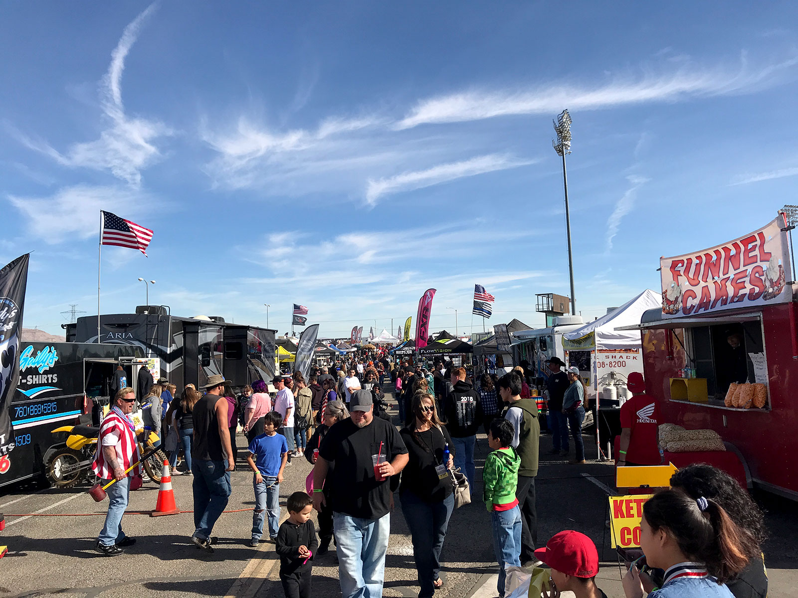 Vendors row is a mash-up of a music festival, trade show, and state fair with plenty of good food and things to do.