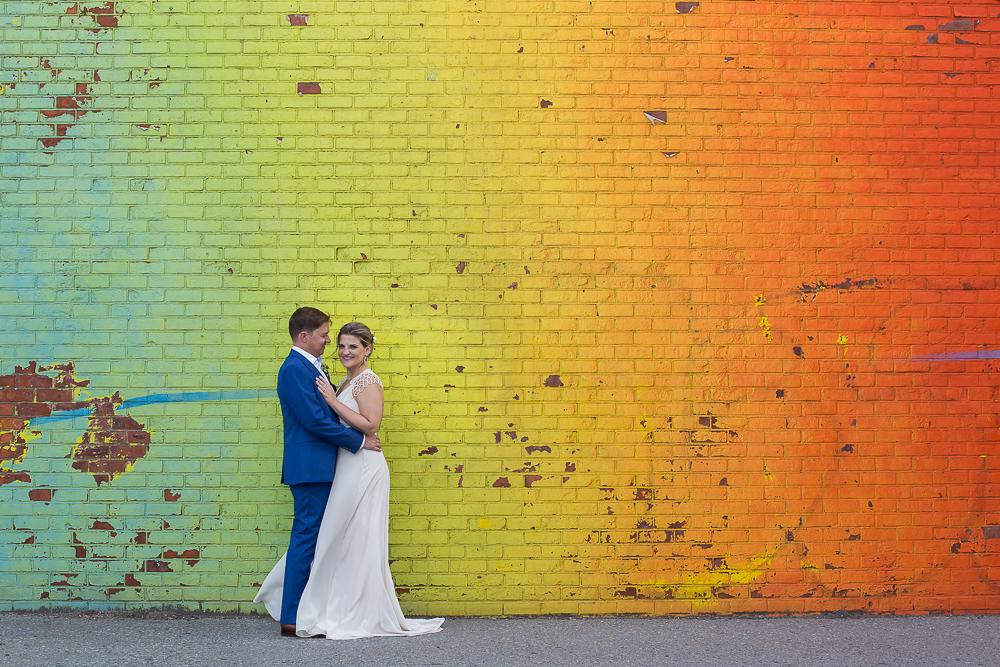 Kate Alison Photography Fleet Alley Rainbow mural DUMBO Brooklyn, NY wedding couple.