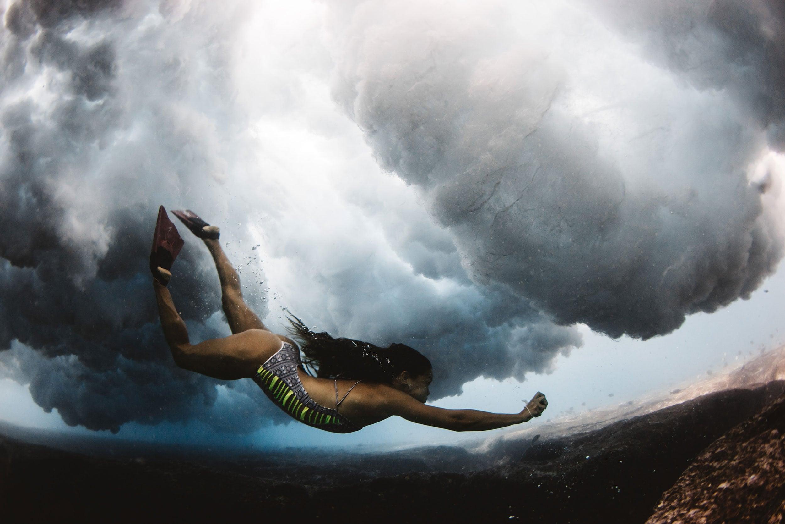 bikini babe below the waves at pipeline