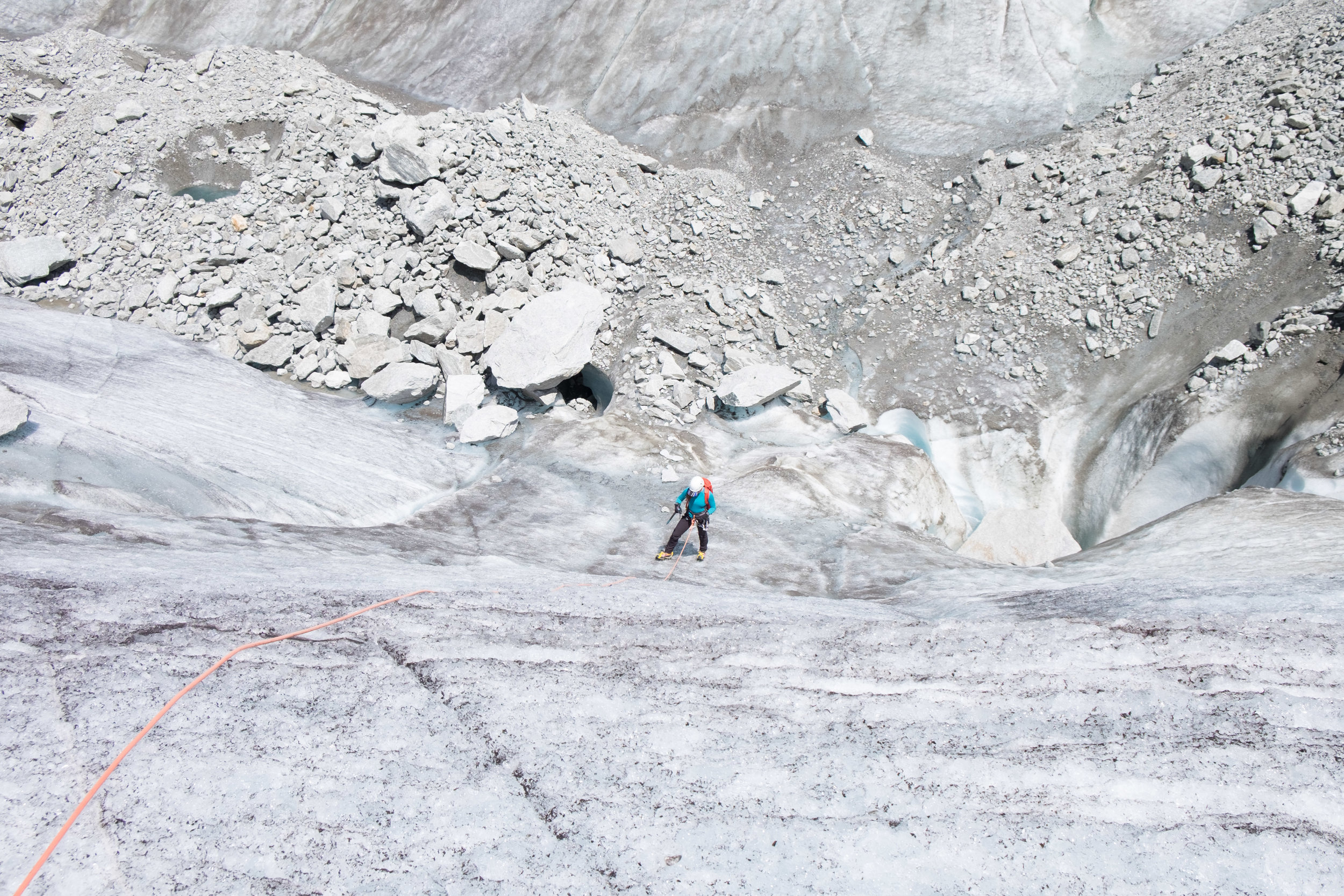 Sophie prepares to font point up a steep ice slope.