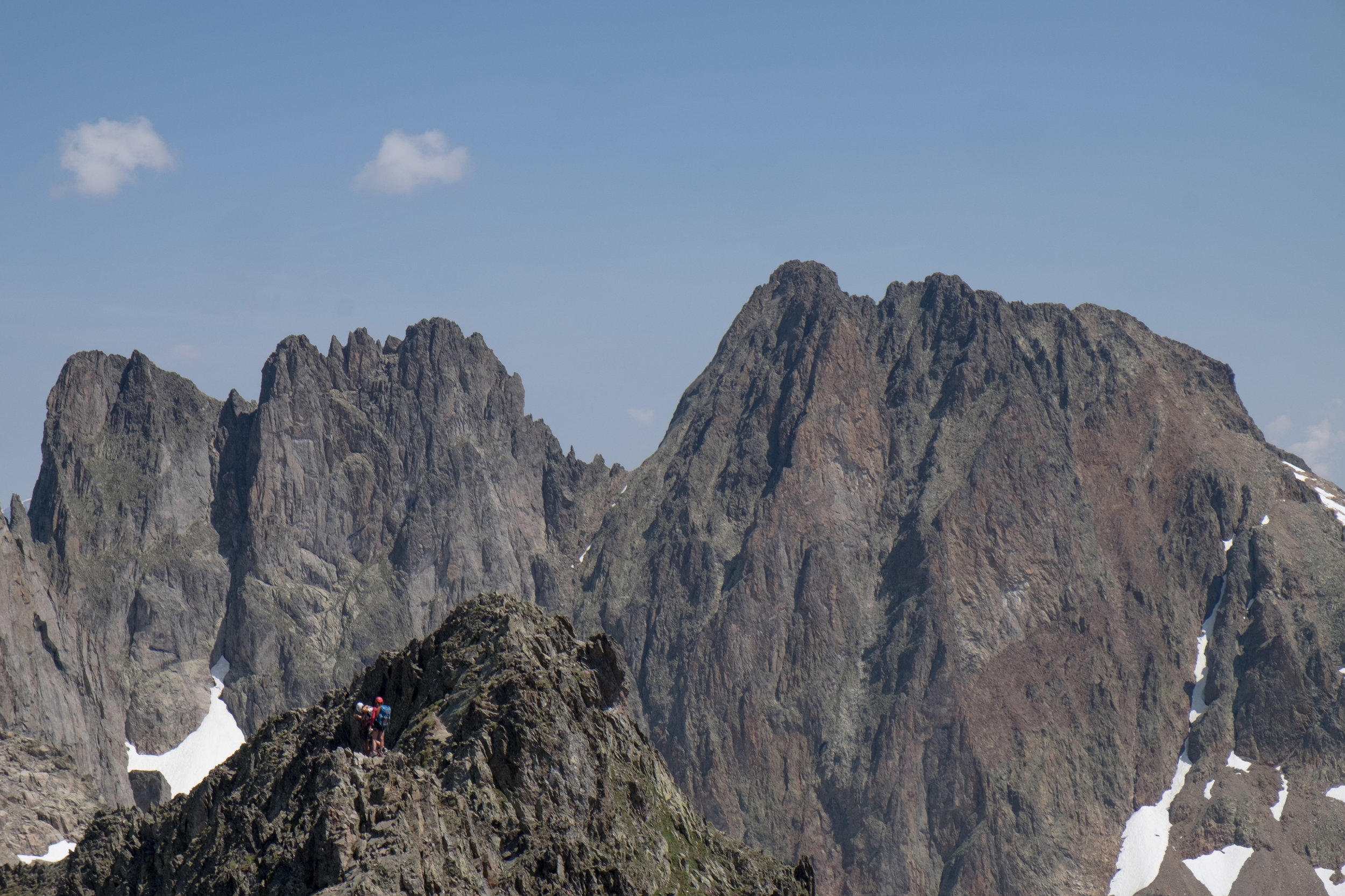 Two climbers descend from the Crochues traverse.