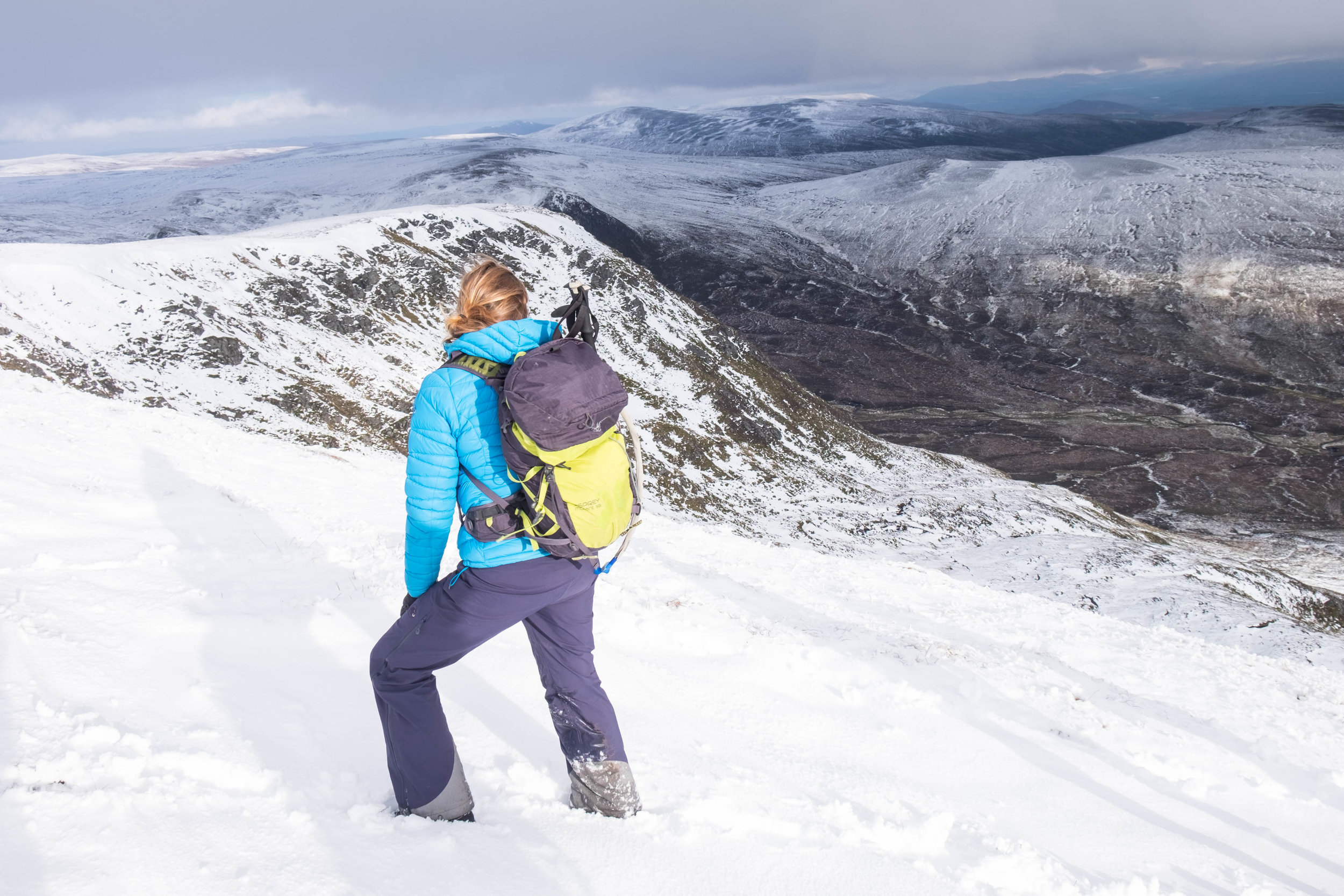 Chrissy looks out over the Monadhliath mountains on one of our group walks.