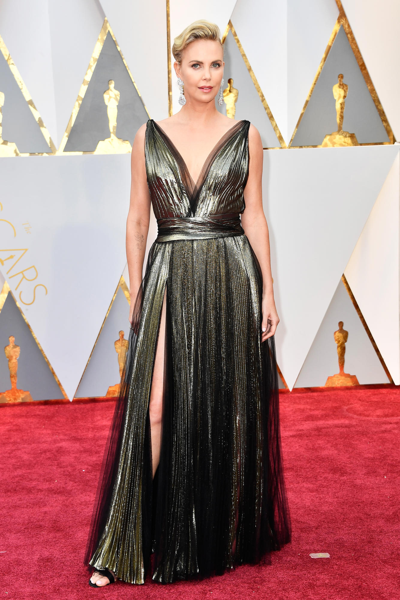 Not my favorite Charlize look, but still stunning. Charlize Theron in Armani Privé