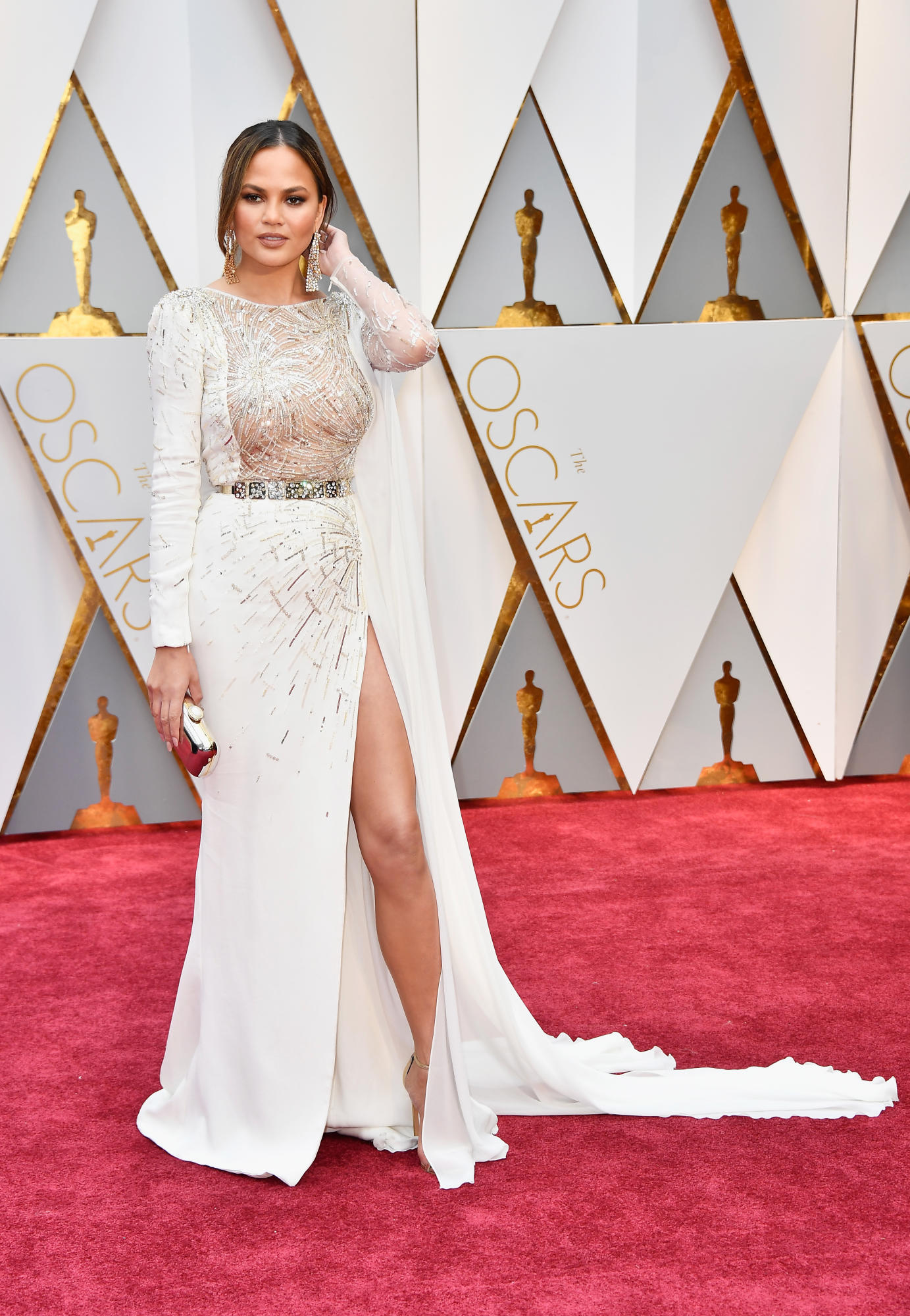 The sheer panel is a smidge distracting but I loved the long sleeve and the high slit. Chrissy Teigen in Zuhair Murad