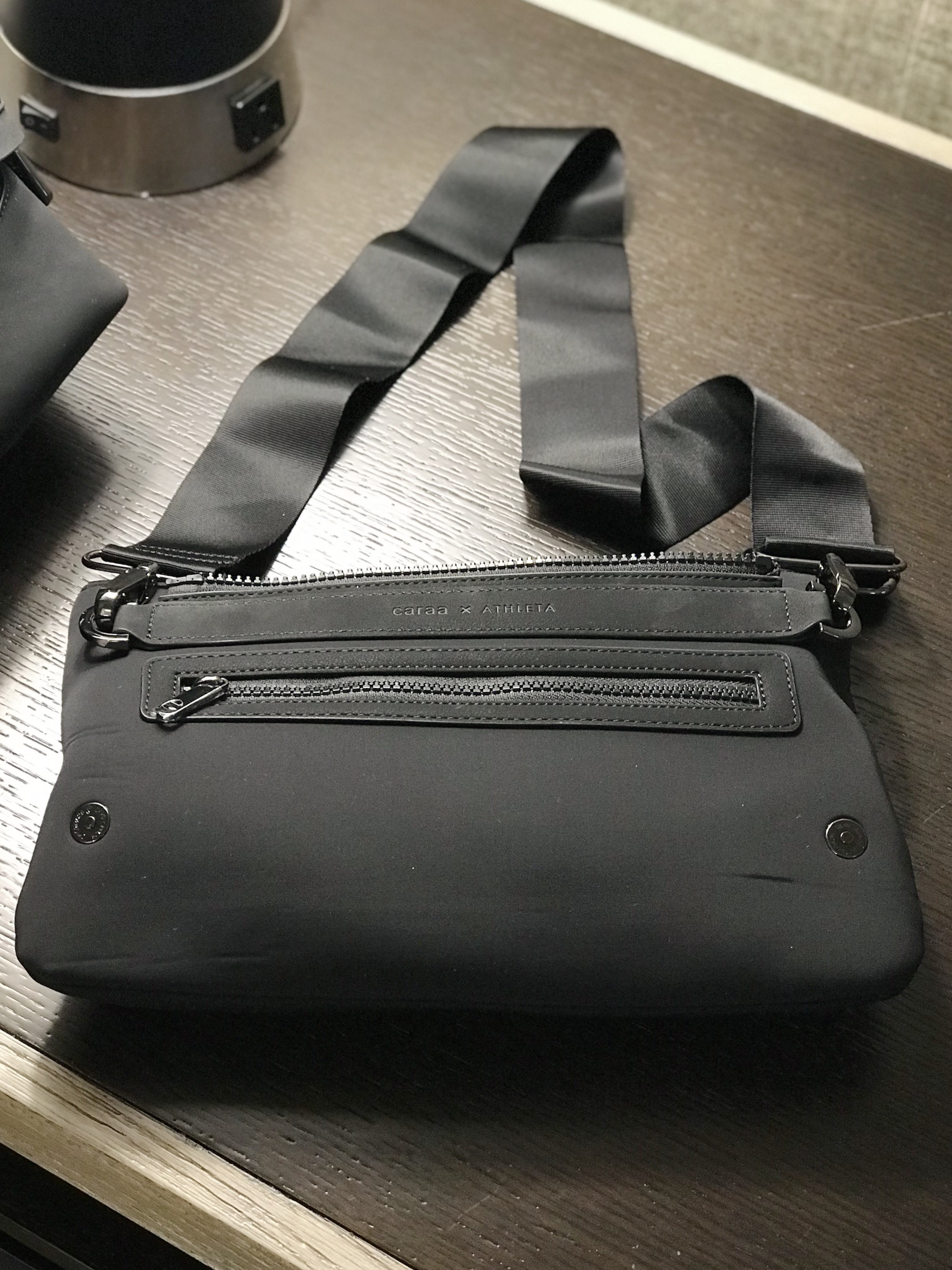 The zip-off pouch comes with a strap to make it a waist bag or a crossbody.