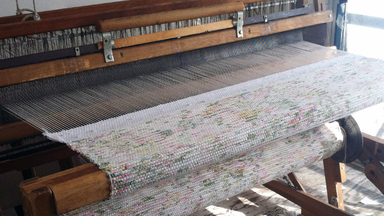 The couple spends an average of 4 hours in their studio, every day of the week, using custom-built looms.