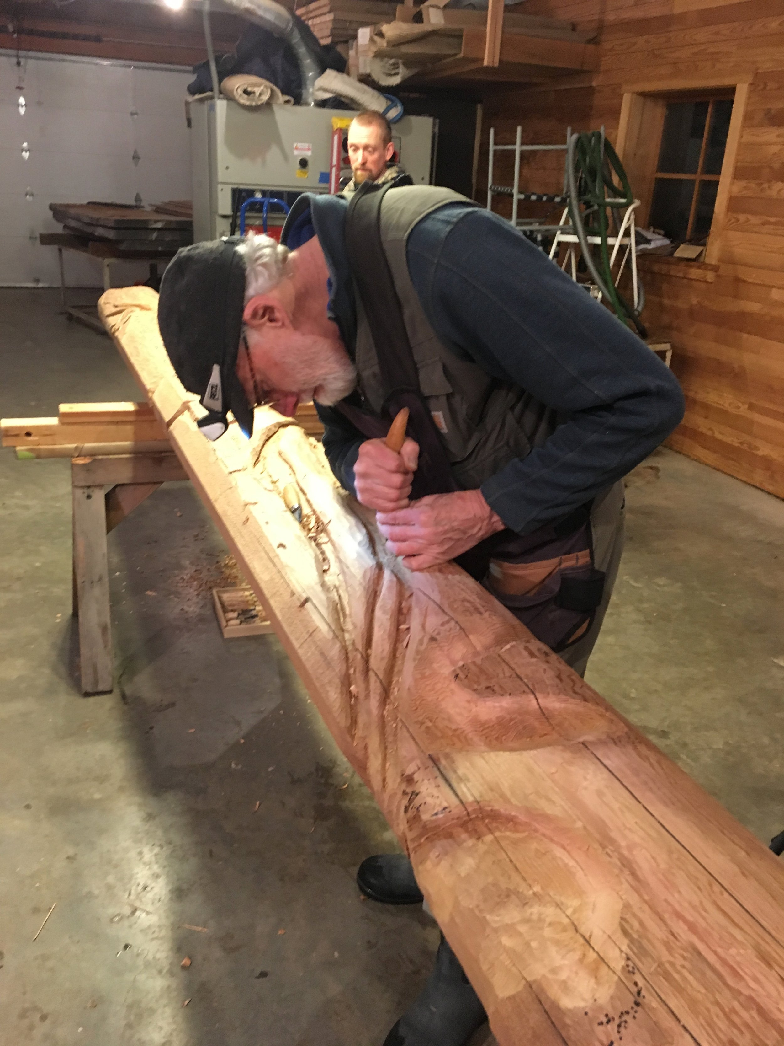 Richard Merrill carving rot pockets in his cedar rendition of a SE Alaskan hemlock snag, true to form.