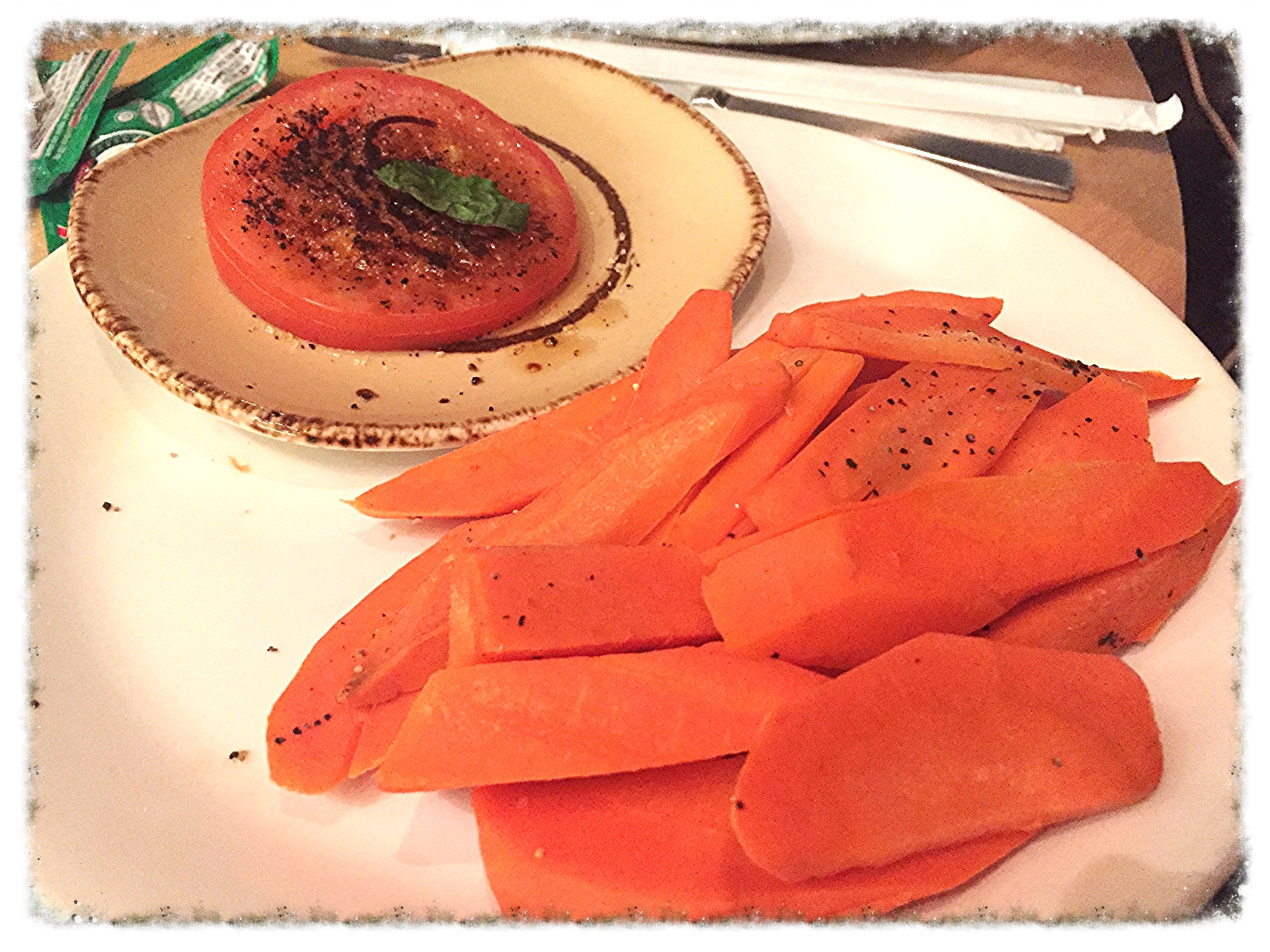 Tomato with olive oil, cracked pepper and salt and carrots from Bacchanal Buffet
