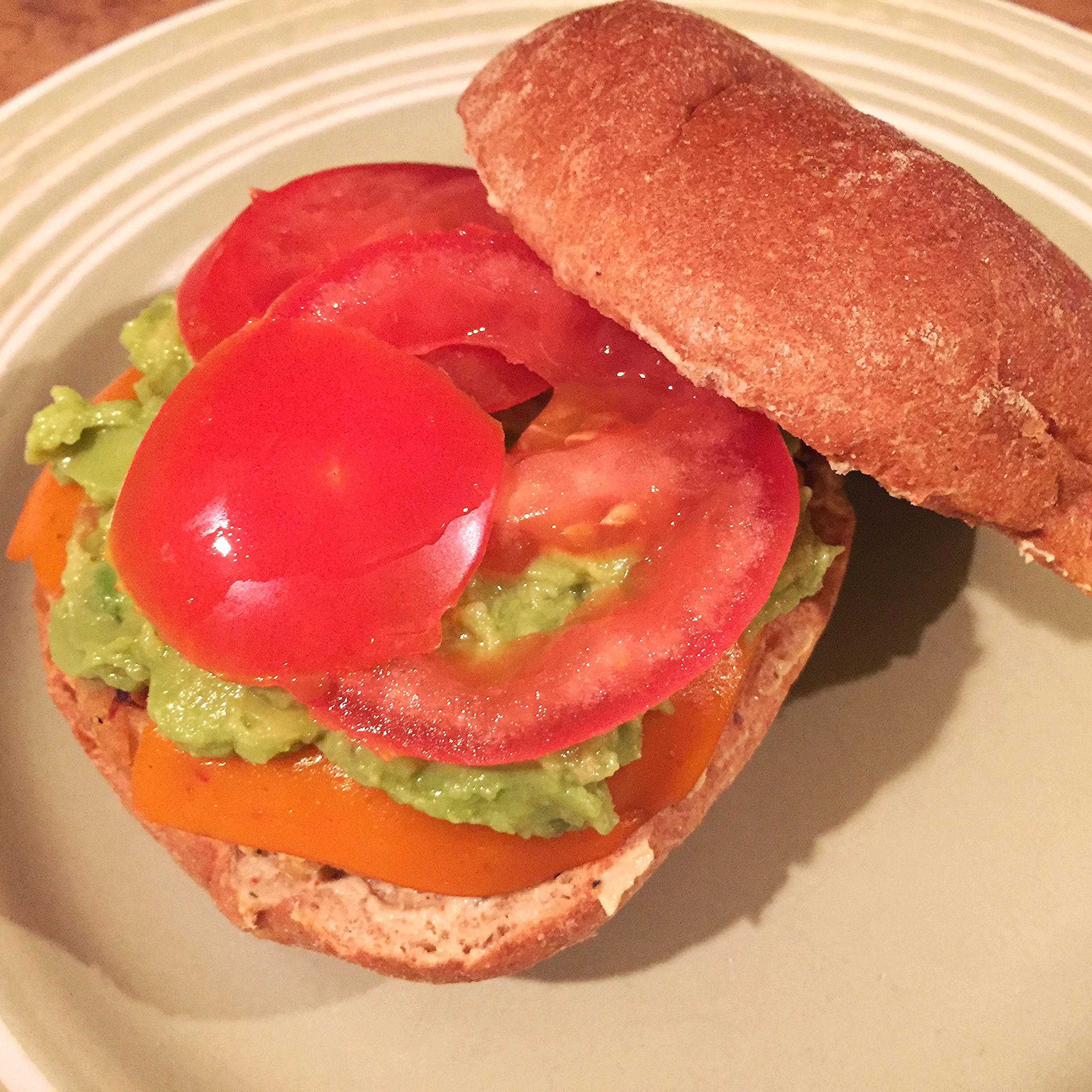 White bean and red lentil burger topped with vegan condiments