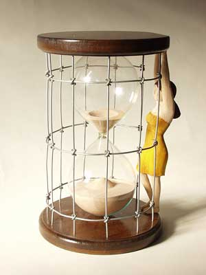 HOURGLASS EMILY  Built with Basswood, Mahogany, steel wire and a found hourglass.