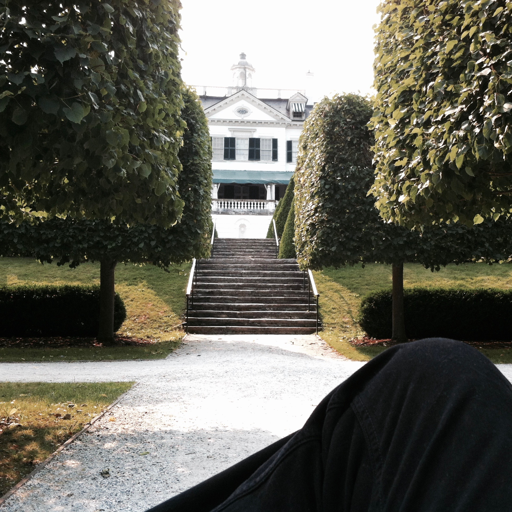 Sitting on a bench in the center of the gardens. — N.M-Y. '15