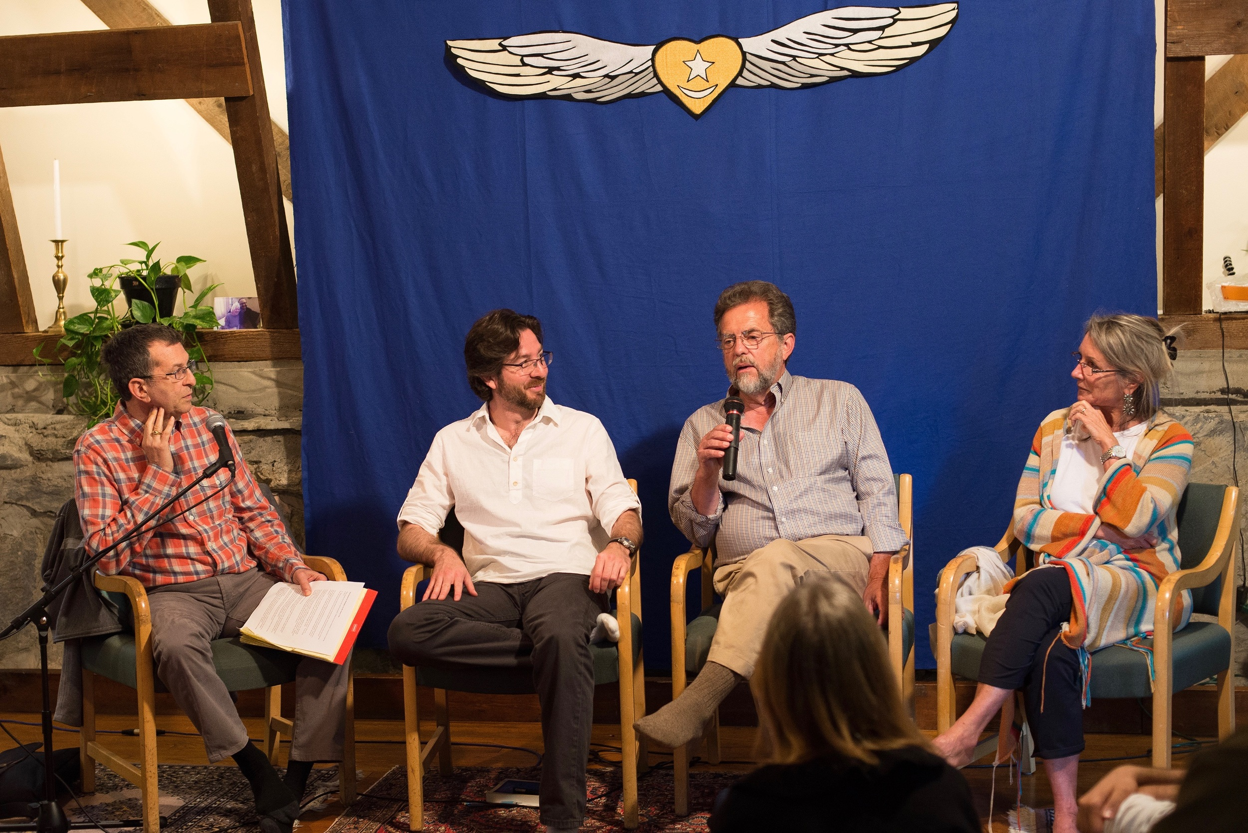 Gayan Macher, Netanel Miles-Yépez, Himayat Inayati (speaking), and   Taj Inayat during the Dialogue on the Inner Life in the Meditation Hall, Abode of the Message. Photo by Hilary Benas, 2015