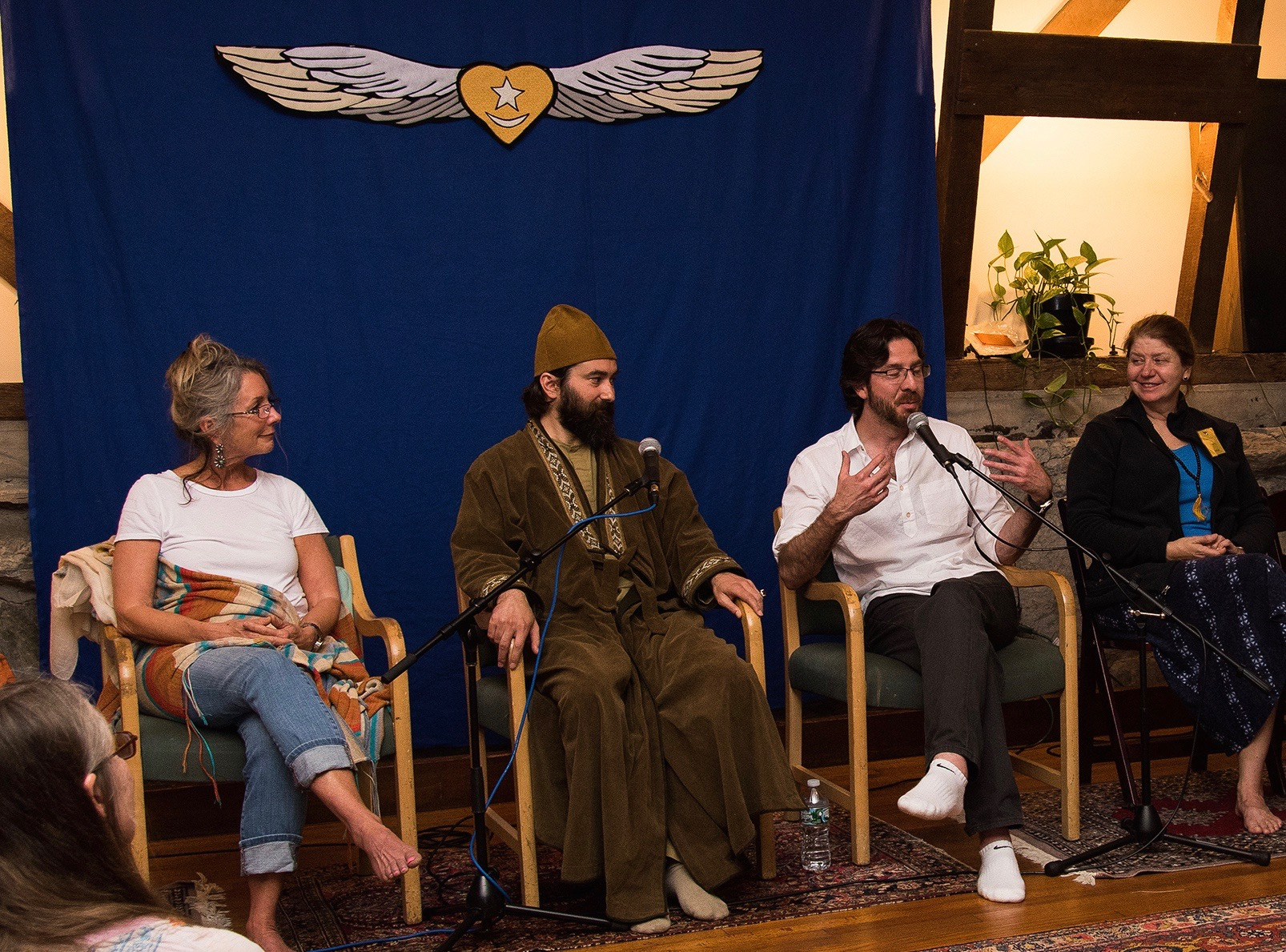 Taj Inayat, Pir Zia Inayat-Khan, and Netanel Miles-Yépez (speaking)   during the  sohbet  session in the Meditation Hall, Abode of the Message. Photo by Hilary Benas, 2015