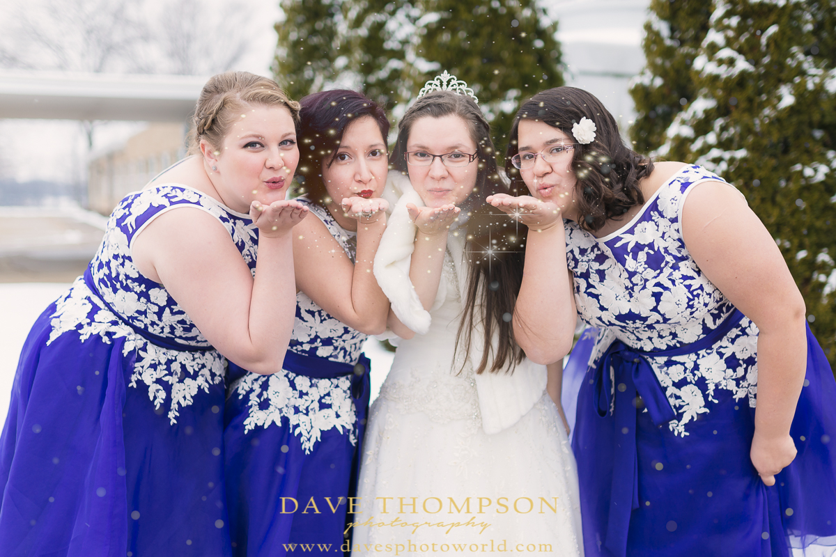 We had such fun with the bridesmaids capturing this winter wonderland picture!  The fresh snow made for a great winter themed shot.