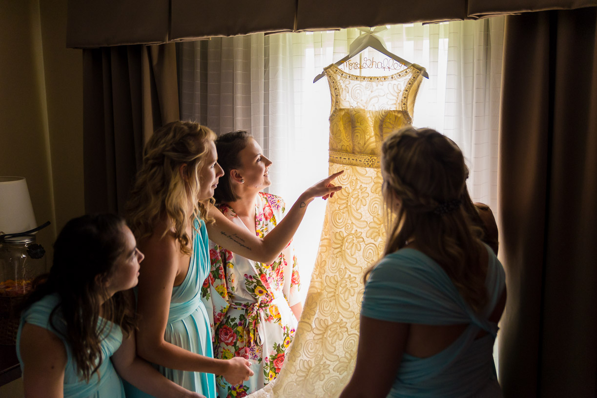 Girls Admiring Beautiful Wedding Dress