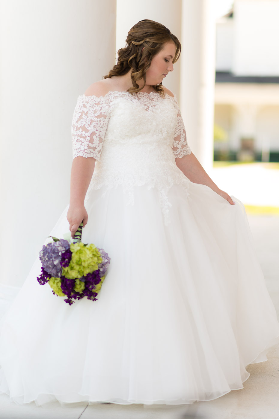Wedding Gown with Green and Purple Bouquet
